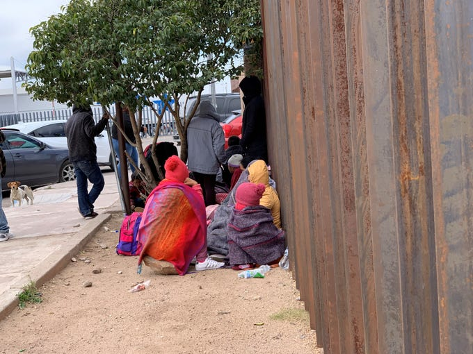 Several families wait to claim asylum on the Mexican side of the Raul H. Castro port of entry in Douglas, Arizona, on March 15, 2019.