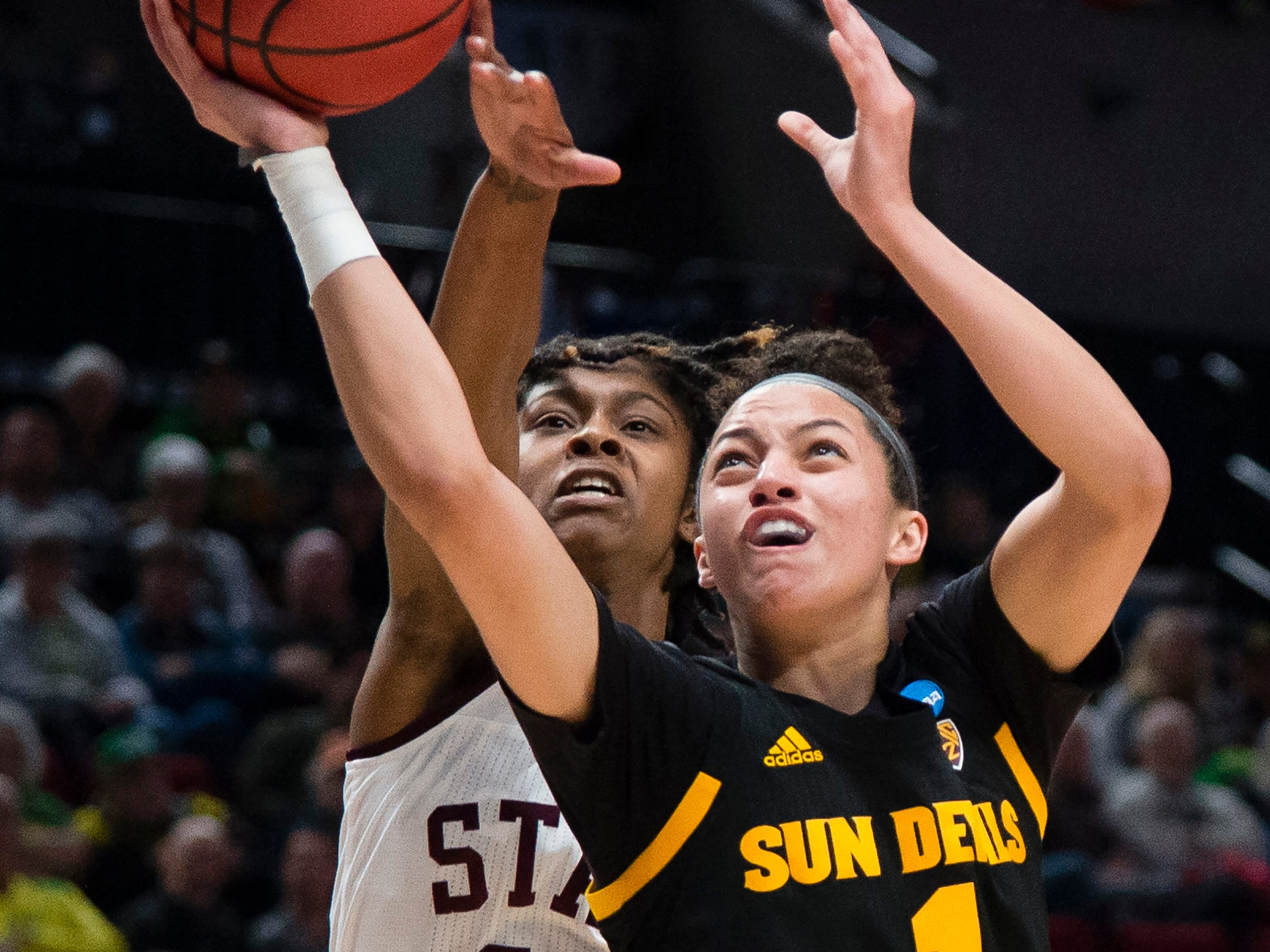 Mar 29, 2019; Portland, OR, USA; Arizona State Sun Devils guard Reili Richardson (1) drives to the basket against Mississippi State Bulldogs guard Jazzmun Holmes (10) during the first half in the semifinals of the Portland regional in the women's 2019 NCAA Tournament at Moda Center.