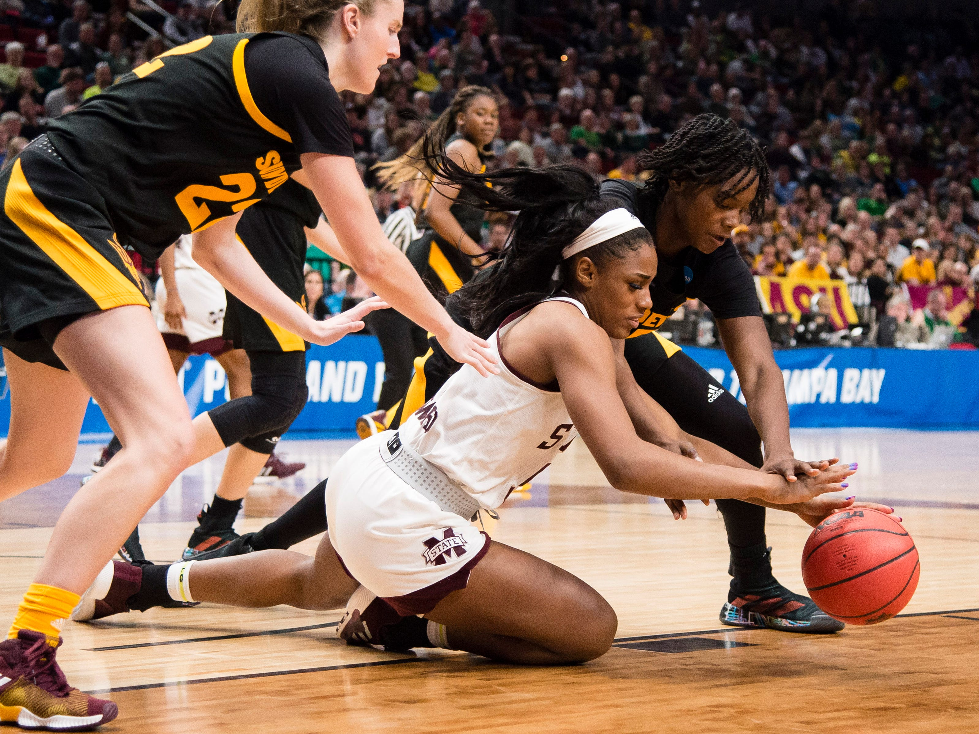 Mar 29, 2019; Portland, OR, USA; Mississippi State Bulldogs forward Anriel Howard (5) scrambles against Arizona State Sun Devils center Charnea Johnson-Chapman (33) to control the ball during the second half in the semifinals of the Portland regional in the women's 2019 NCAA Tournament at Moda Center. The Mississippi State Bulldogs beat the Arizona State Sun Devils 76-53.