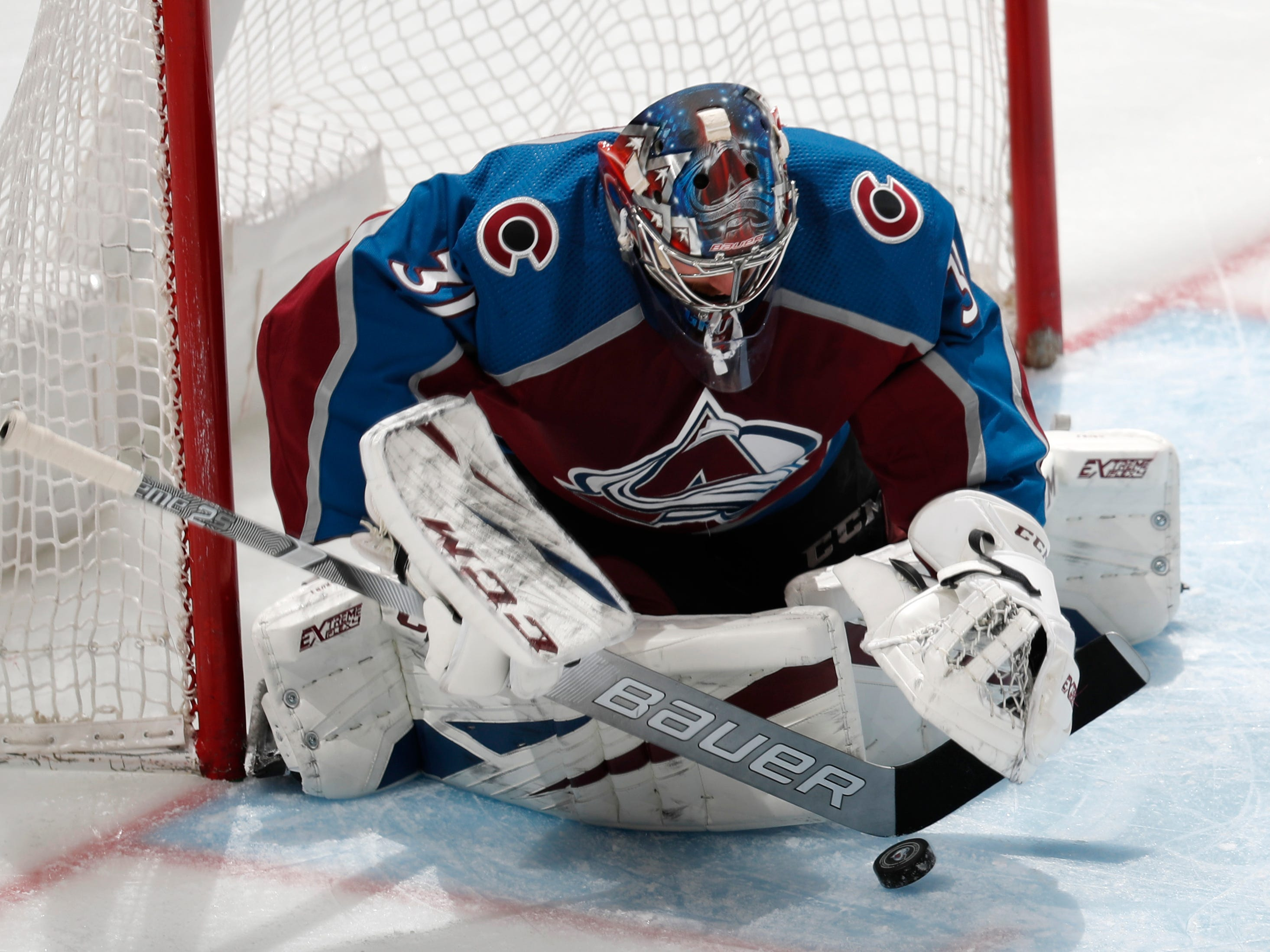 Colorado Avalanche goaltender Philipp Grubauer makes a stick-save against the Arizona Coyotes in the first period of an NHL hockey game Friday, March 29, 2019, in Denver.