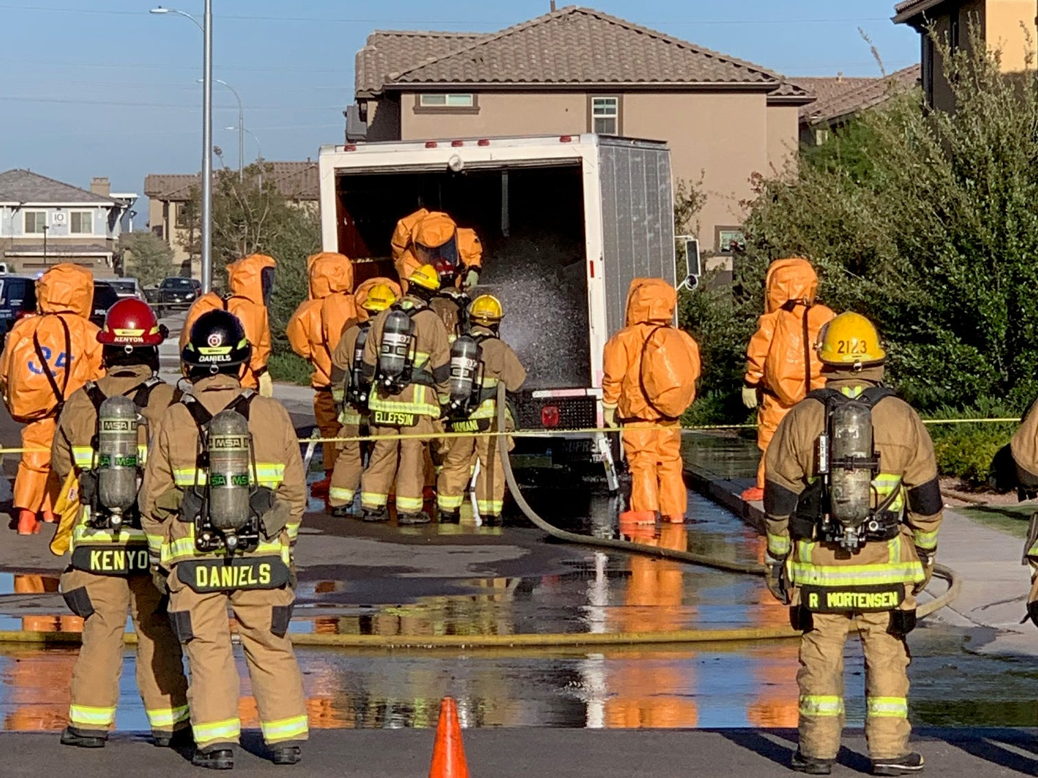 Gilbert police and fire personnel respond after a crash between a vehicle and a truck carrying several barrels of phosphorus caused a spill near Queen Creek Road and Arizona Avenue in Chandler on March 29, 2019. Several houses in the area were evacuated.