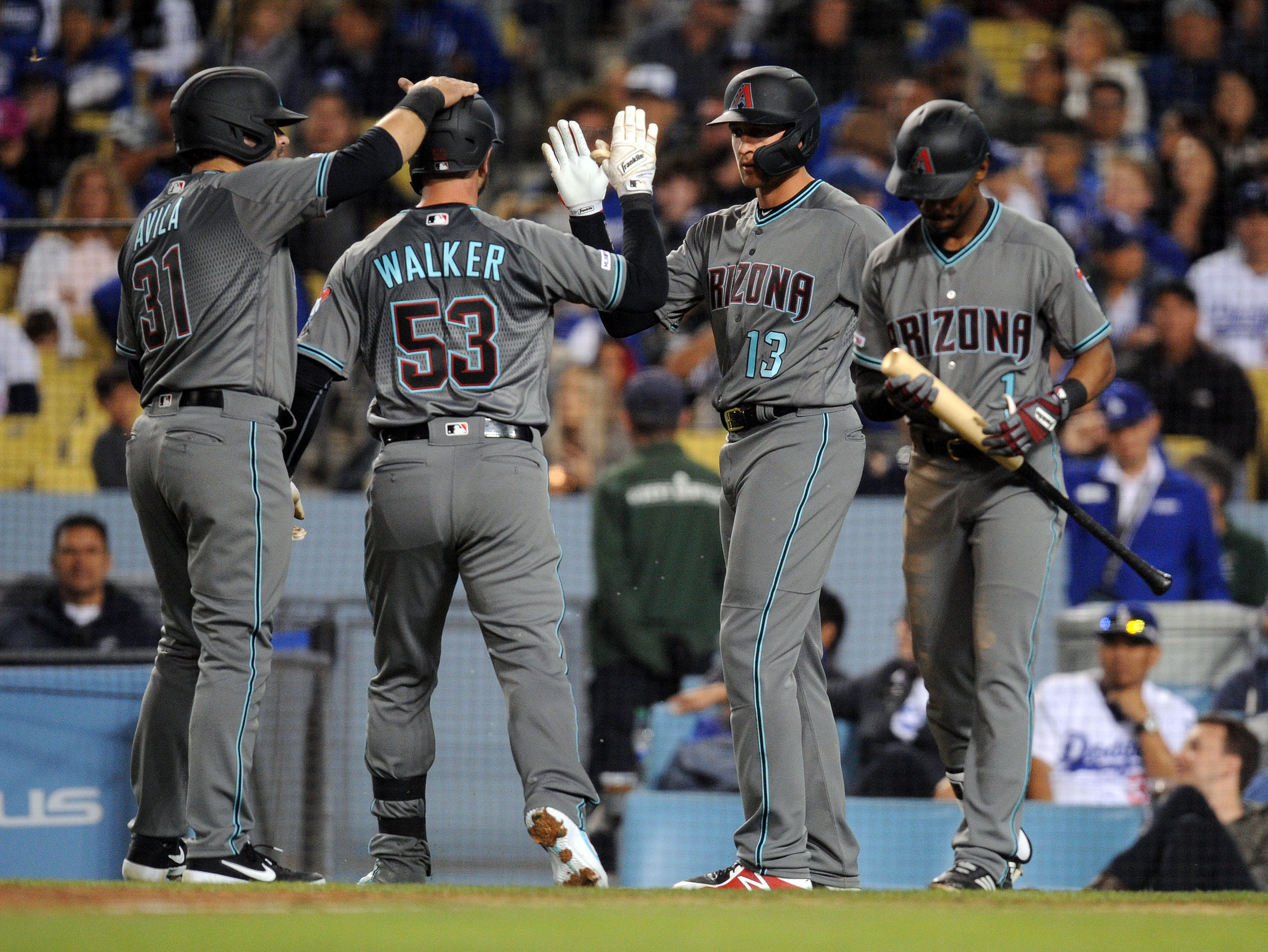 March 29, 2019; Los Angeles, CA, USA; Arizona Diamondbacks first baseman Christian Walker (53) is greeted by catcher Alex Avila (31) and shortstop Nick Ahmed (13) after hitting a three run home run against the Los Angeles Dodgers during the seventh inning at Dodger Stadium. Mandatory Credit: Gary A. Vasquez-USA TODAY Sports