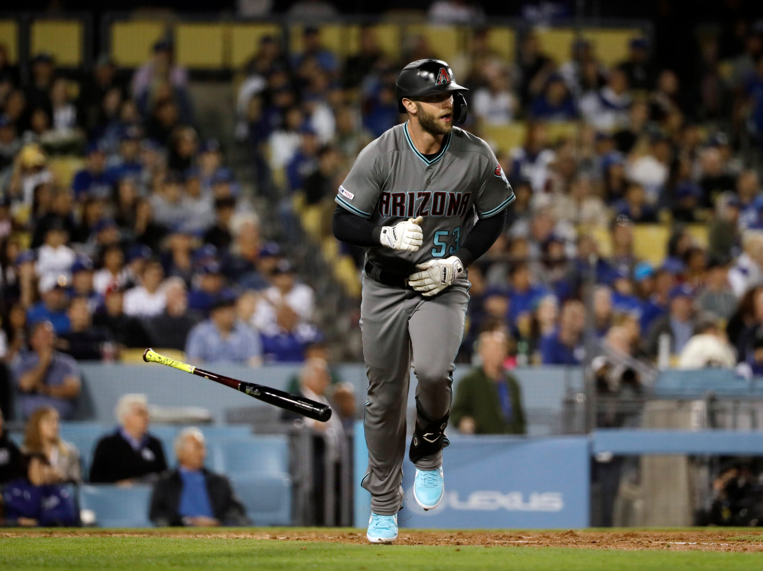 Arizona Diamondbacks' Christian Walker drops his bat after hitting a three-run home run against the Los Angeles Dodgers during the seventh inning of a baseball game Friday, March 29, 2019, in Los Angeles. (AP Photo/Marcio Jose Sanchez)