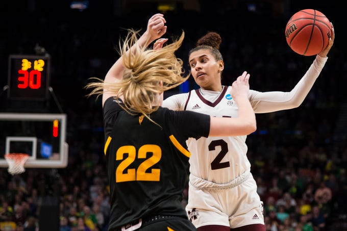 Mar 29, 2019; Portland, OR, USA; Mississippi State Bulldogs guard Andra Espinoza-Hunter (2) works to the basket during the second half against Arizona State Sun Devils guard Courtney Ekmark (22) in the semifinals of the Portland regional in the women's 2019 NCAA Tournament at Moda Center. The Mississippi State Bulldogs beat the Arizona State Sun Devils 76-53.