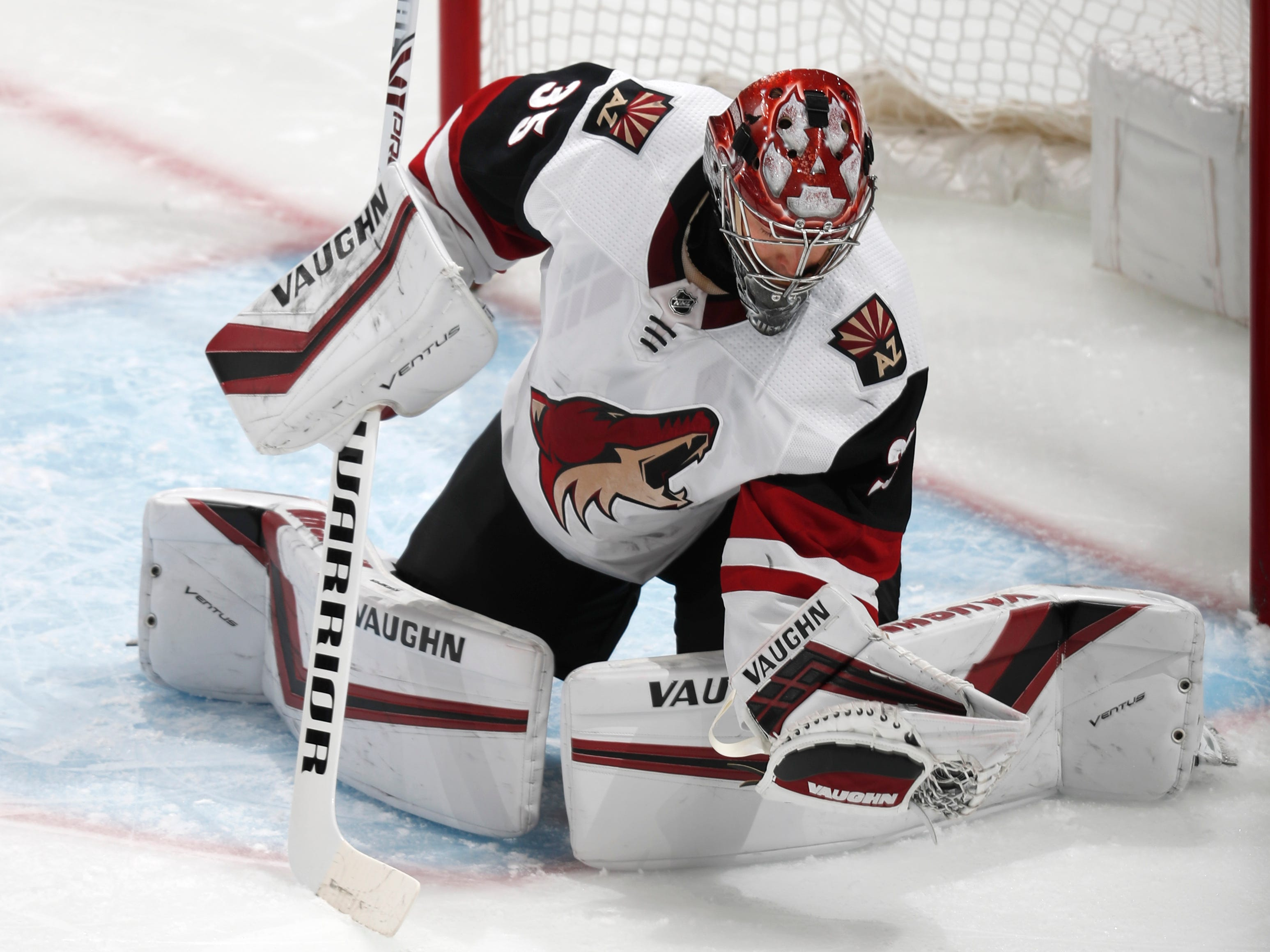 Arizona Coyotes goaltender Darcy Kuemper makes a glove-save against the Colorado Avalanche in the first period of an NHL hockey game Friday, March 29, 2019, in Denver.