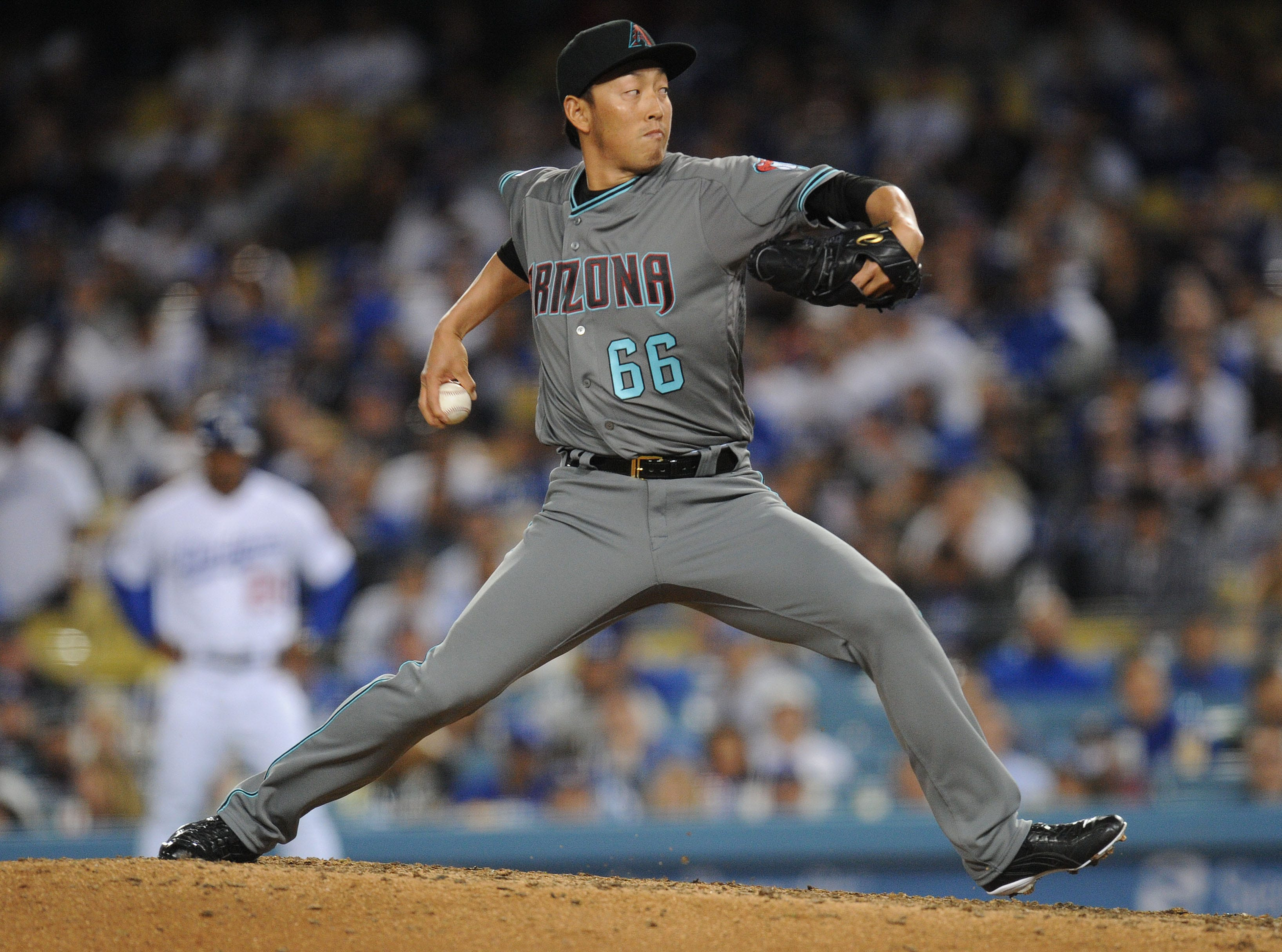 March 29, 2019; Los Angeles, CA, USA; Arizona Diamondbacks relief pitcher Yoshihisa Hirano (66) throws against the Los Angeles Dodgers during the seventh inning at Dodger Stadium. Mandatory Credit: Gary A. Vasquez-USA TODAY Sports