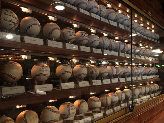 Wall of signed baseballs inside Don & Charlie's restaurant in Scottsdale on March 29, 2019.