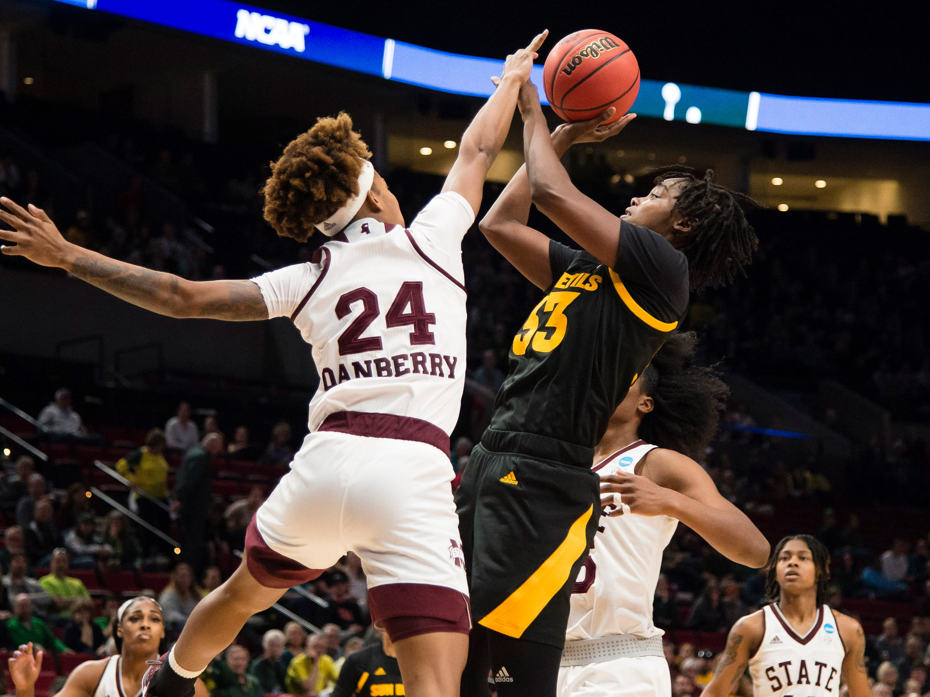 Mar 29, 2019; Portland, OR, USA; Arizona State Sun Devils center Charnea Johnson-Chapman (33) shoots a basket against Mississippi State Bulldogs guard Jordan Danberry (24) during the first half in the semifinals of the Portland regional in the women's 2019 NCAA Tournament at Moda Center.