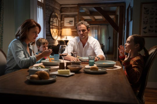 "What a beautiful family: Louis (Jason Clarke) and Rachel (Amy Seimetz) eat with their children (Hugo Lavoie and Jeté Laurence) in ""Pet Sematary."""