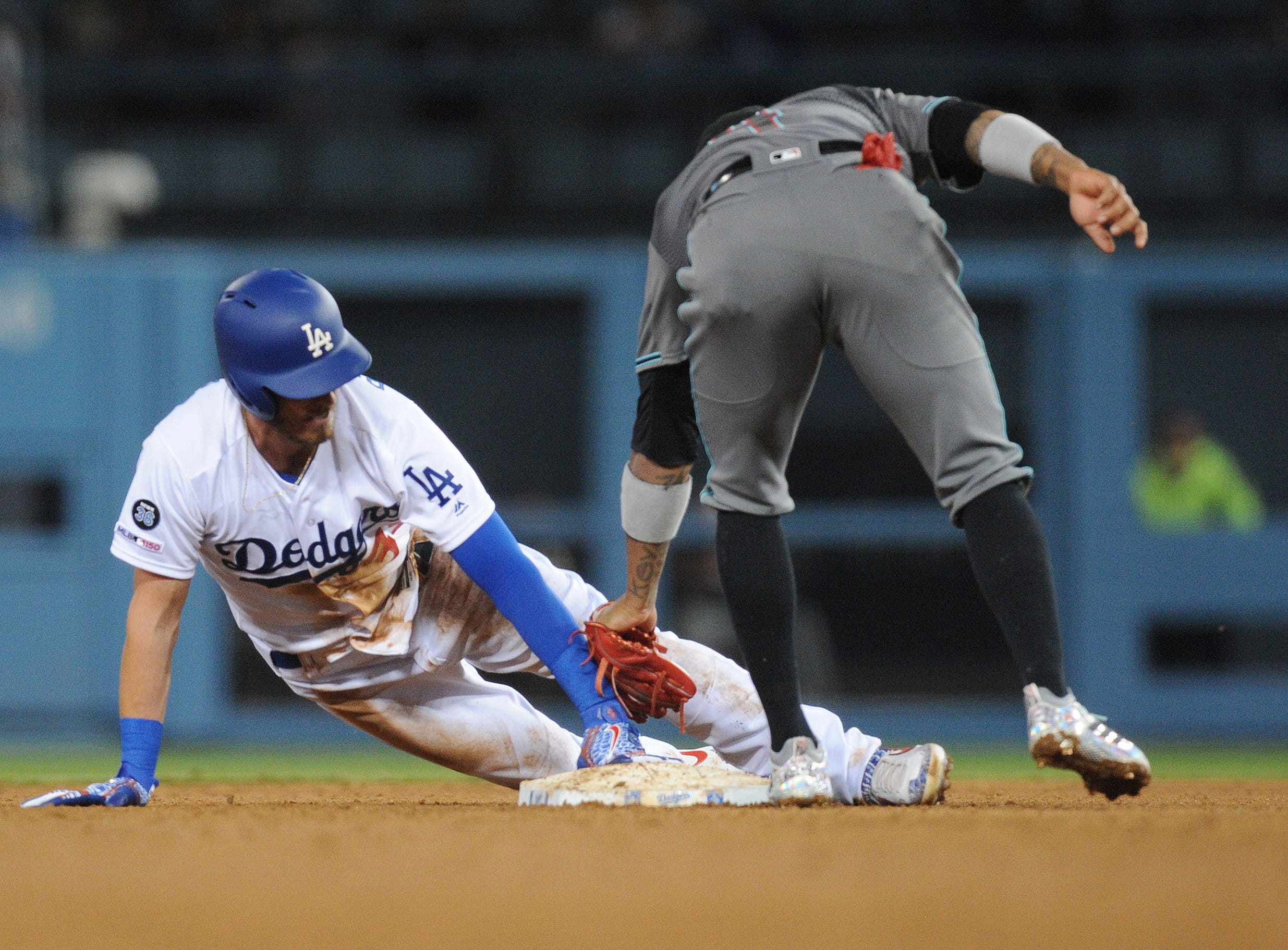 March 29, 2019; Los Angeles, CA, USA; Los Angeles Dodgers right fielder Cody Bellinger (35) steals second against the Arizona Diamondbacks during the fourth inning at Dodger Stadium. Mandatory Credit: Gary A. Vasquez-USA TODAY Sports