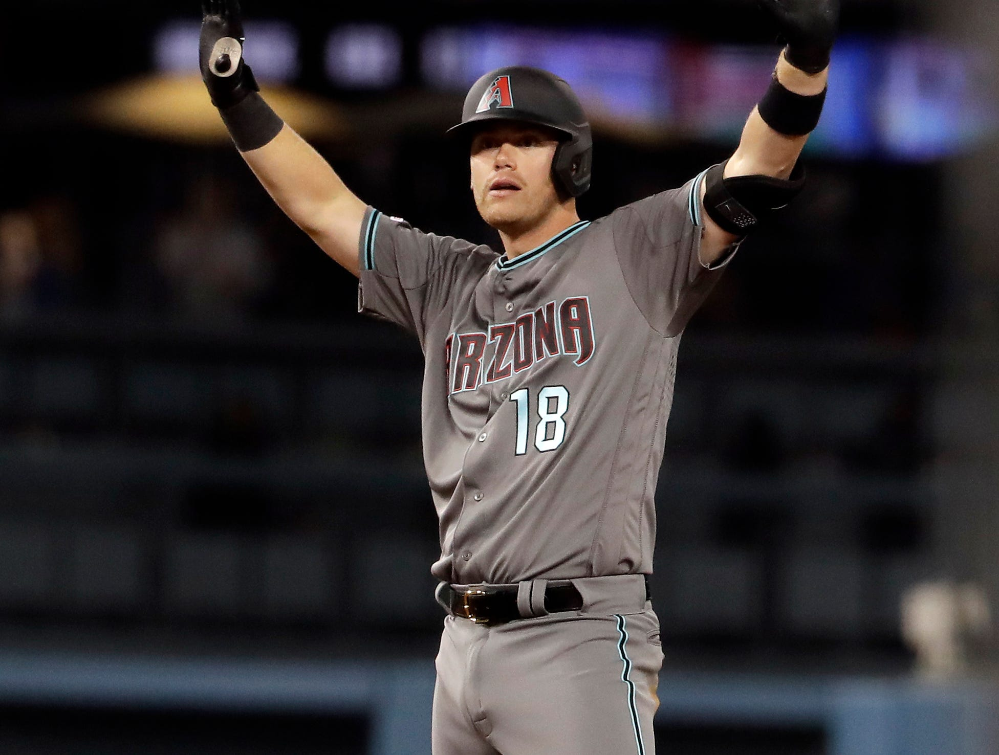 Arizona Diamondbacks' Carson Kelly celebrates after his RBI double during the 13th inning of a baseball game against the Los Angeles Dodgers Saturday, March 30, 2019, in Los Angeles. (AP Photo/Marcio Jose Sanchez)