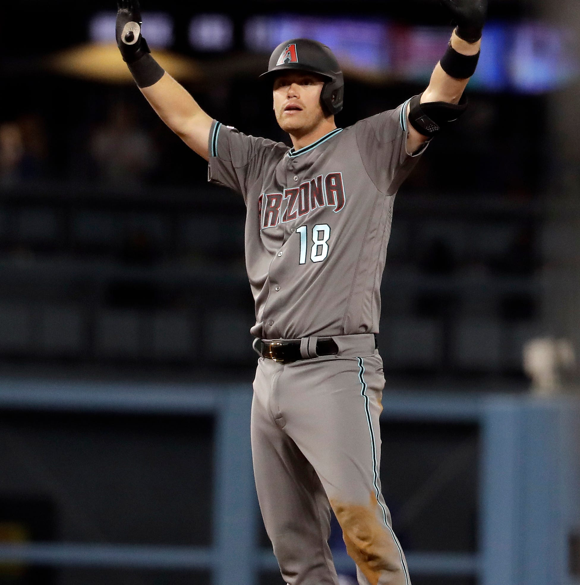 Clutch hitting drives Diamondbacks 6-hour marathon win over Dodgers
