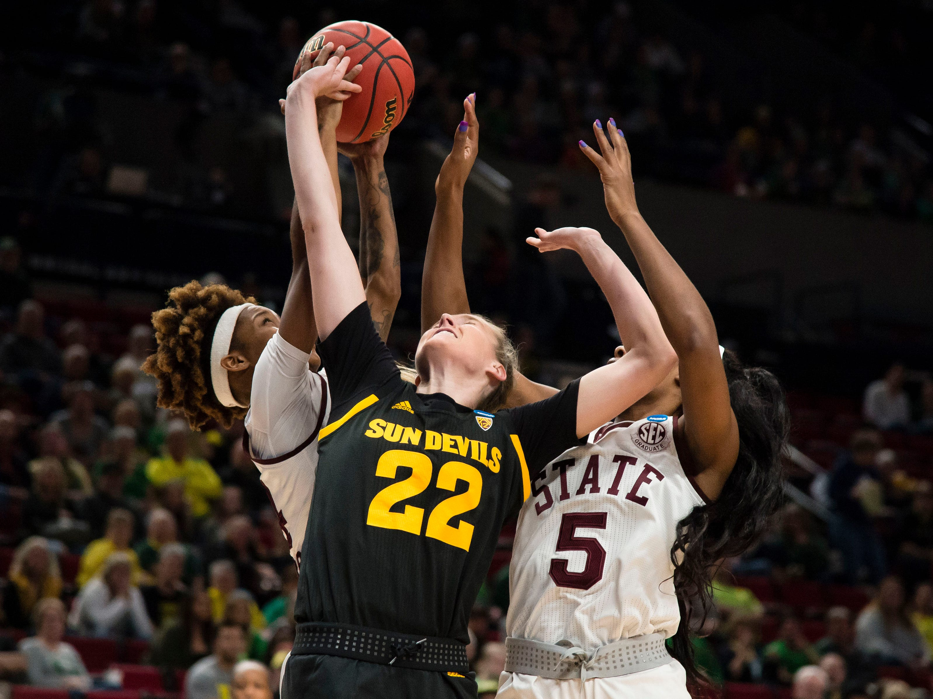 Mar 29, 2019; Portland, OR, USA; Arizona State Sun Devils guard Courtney Ekmark (22) struggles to control a rebound against Mississippi State Bulldogs guard Jordan Danberry (24) and forward Anriel Howard (5) during the first half in the semifinals of the Portland regional in the women's 2019 NCAA Tournament at Moda Center.