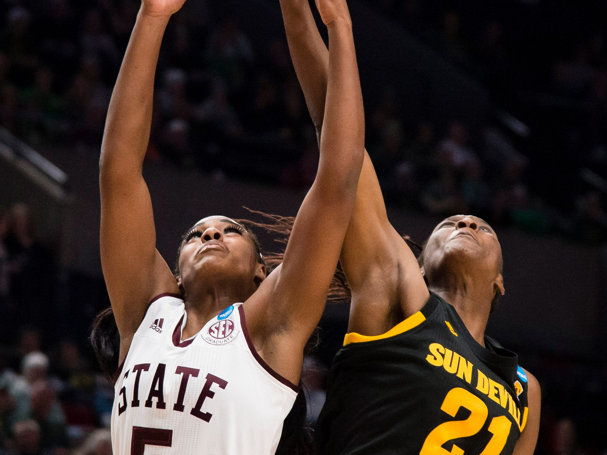 Mar 29, 2019; Portland, OR, USA; Mississippi State Bulldogs forward Anriel Howard (5) and Arizona State Sun Devils forward Sophia Elenga (21) battle for a rebound during the first half in the semifinals of the Portland regional in the women's 2019 NCAA Tournament at Moda Center.