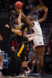 Mar 29, 2019; Portland, OR, USA; Mississippi State Bulldogs center Teaira McCowan (15) controls an offensive rebound against Arizona State Sun Devils guard Kiara Russell (4) during the first half in the semifinals of the Portland regional in the women's 2019 NCAA Tournament at Moda Center.