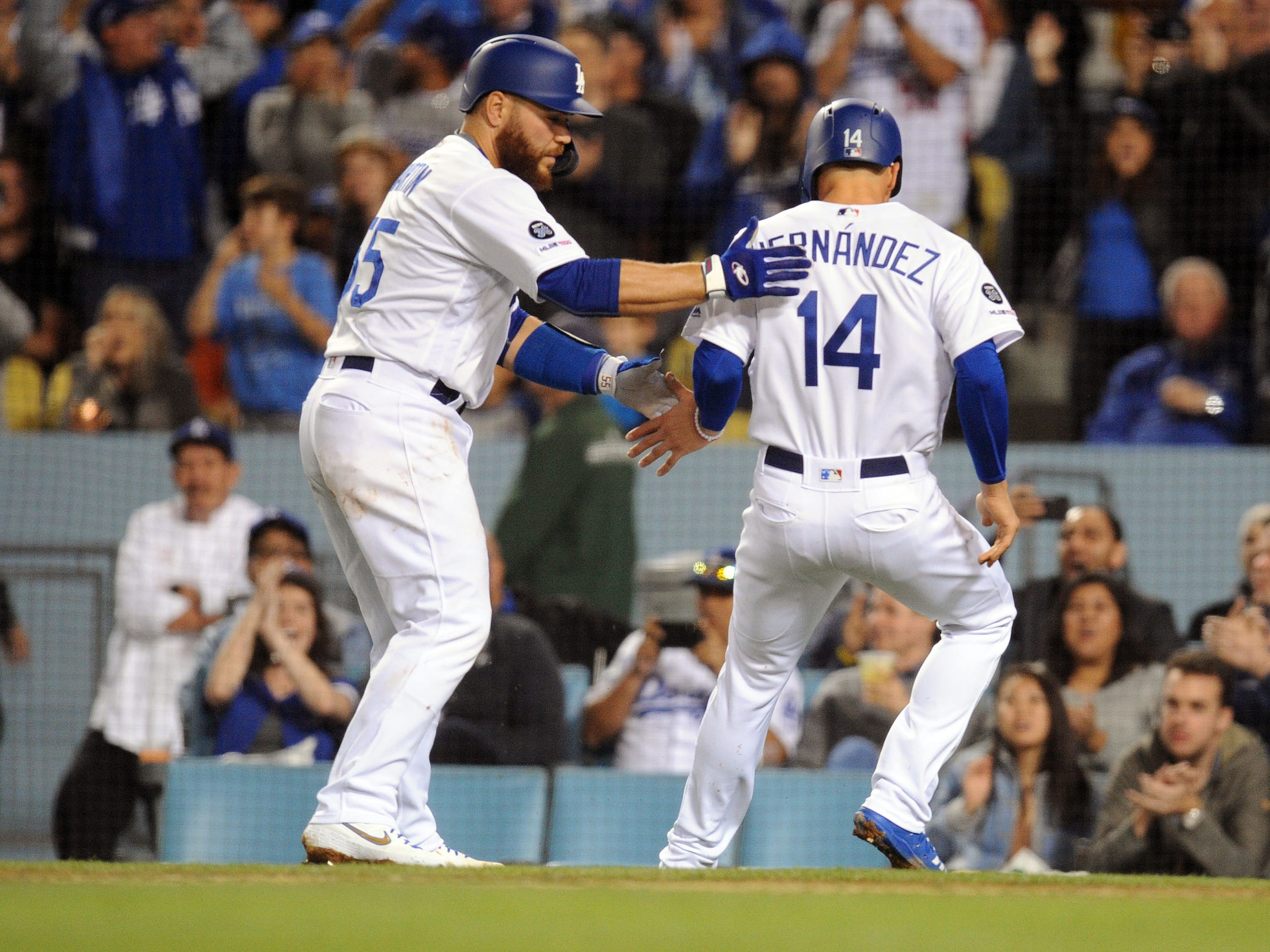 March 29, 2019; Los Angeles, CA, USA; Los Angeles Dodgers catcher Russell Martin (55) greets center fielder Enrique Hernandez (14) after both scoring runs against the Arizona Diamondbacks during the third inning at Dodger Stadium.