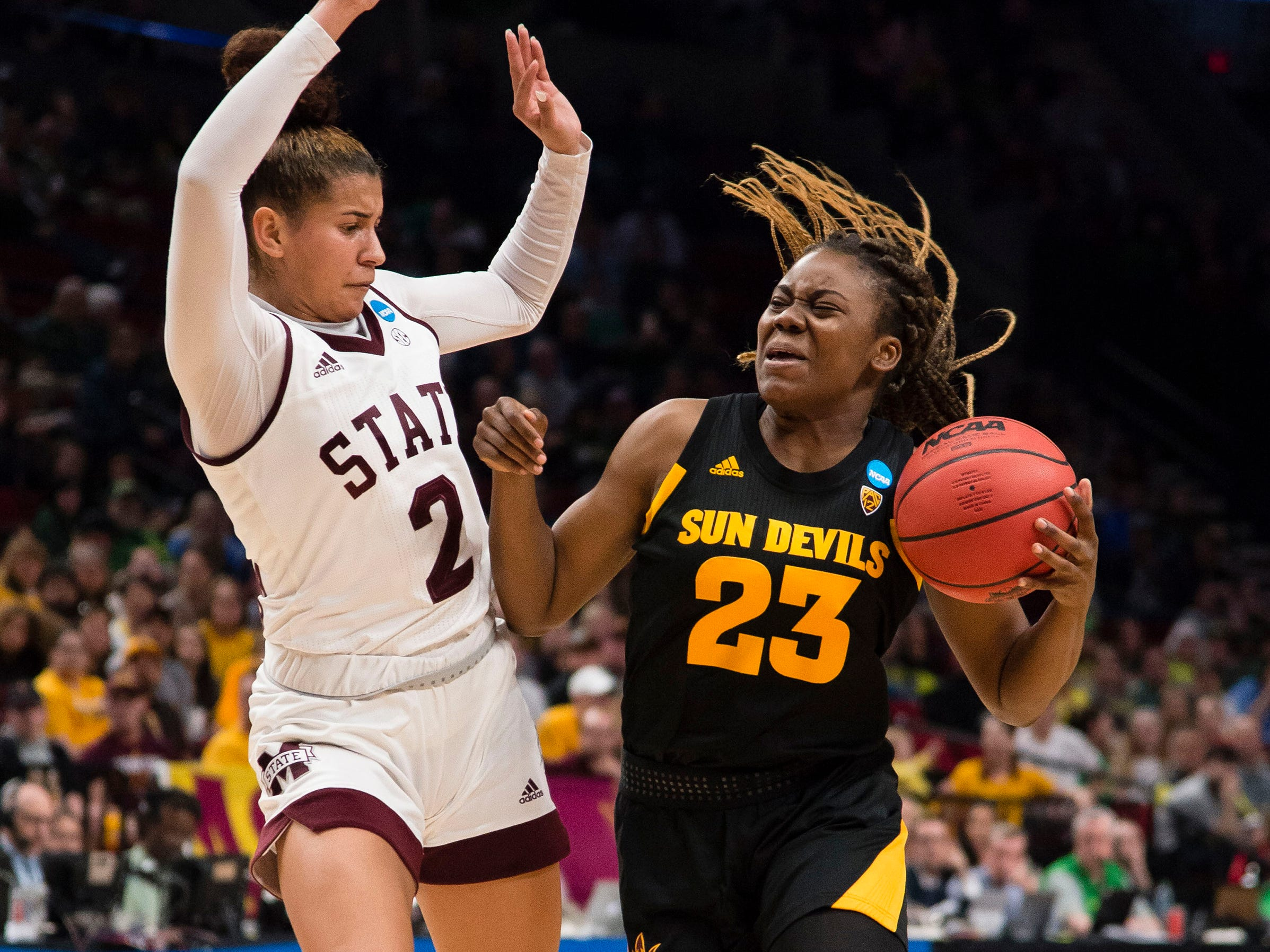Mar 29, 2019; Portland, OR, USA; Arizona State Sun Devils guard Iris Mbulito (23) drives to the basket against Mississippi State Bulldogs guard Andra Espinoza-Hunter (2) during the first half in the semifinals of the Portland regional in the women's 2019 NCAA Tournament at Moda Center.