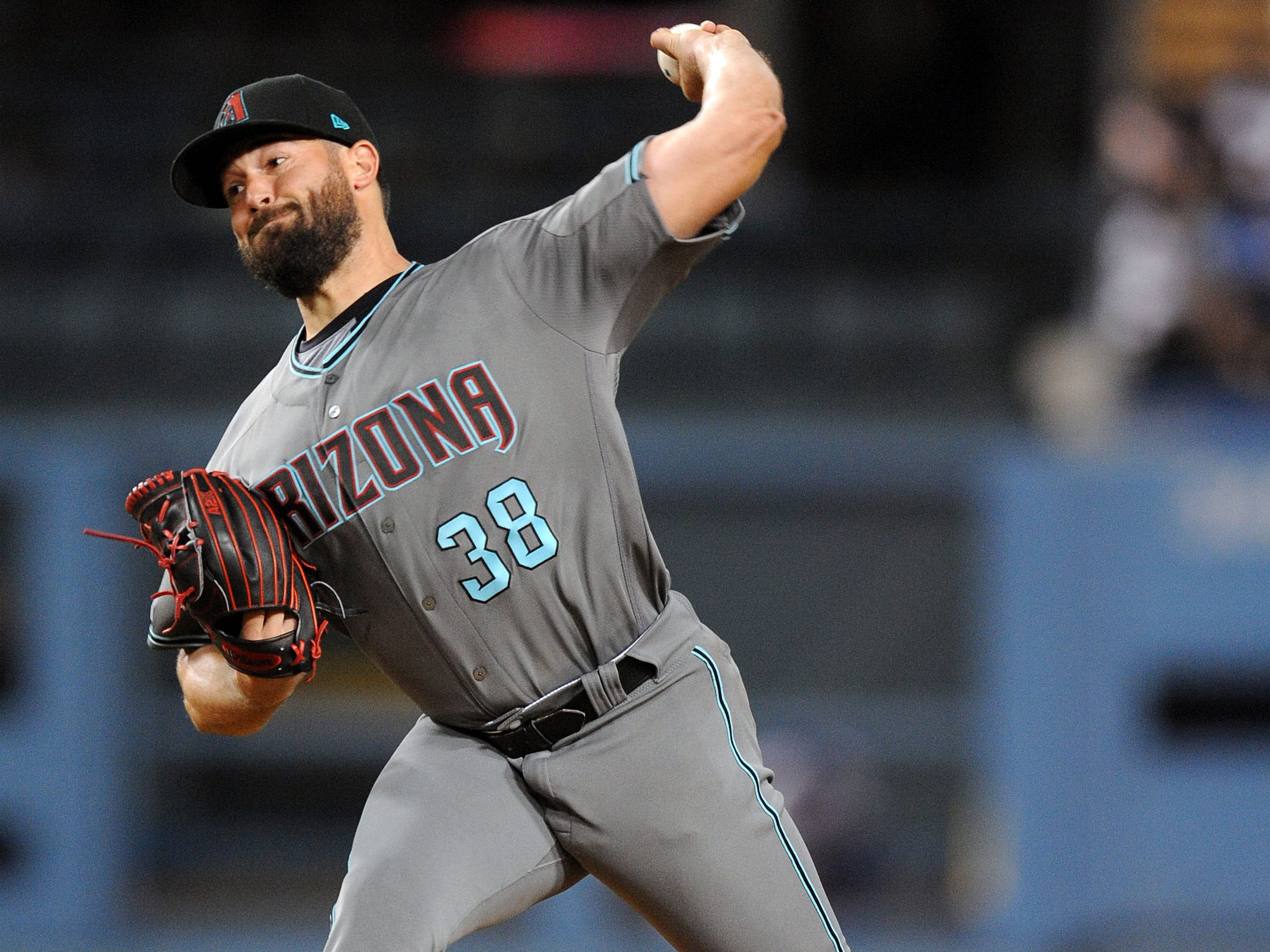 March 29, 2019; Los Angeles, CA, USA; Arizona Diamondbacks starting pitcher Robbie Ray (38) throws during the second inning against the Los Angeles Dodgers at Dodger Stadium.