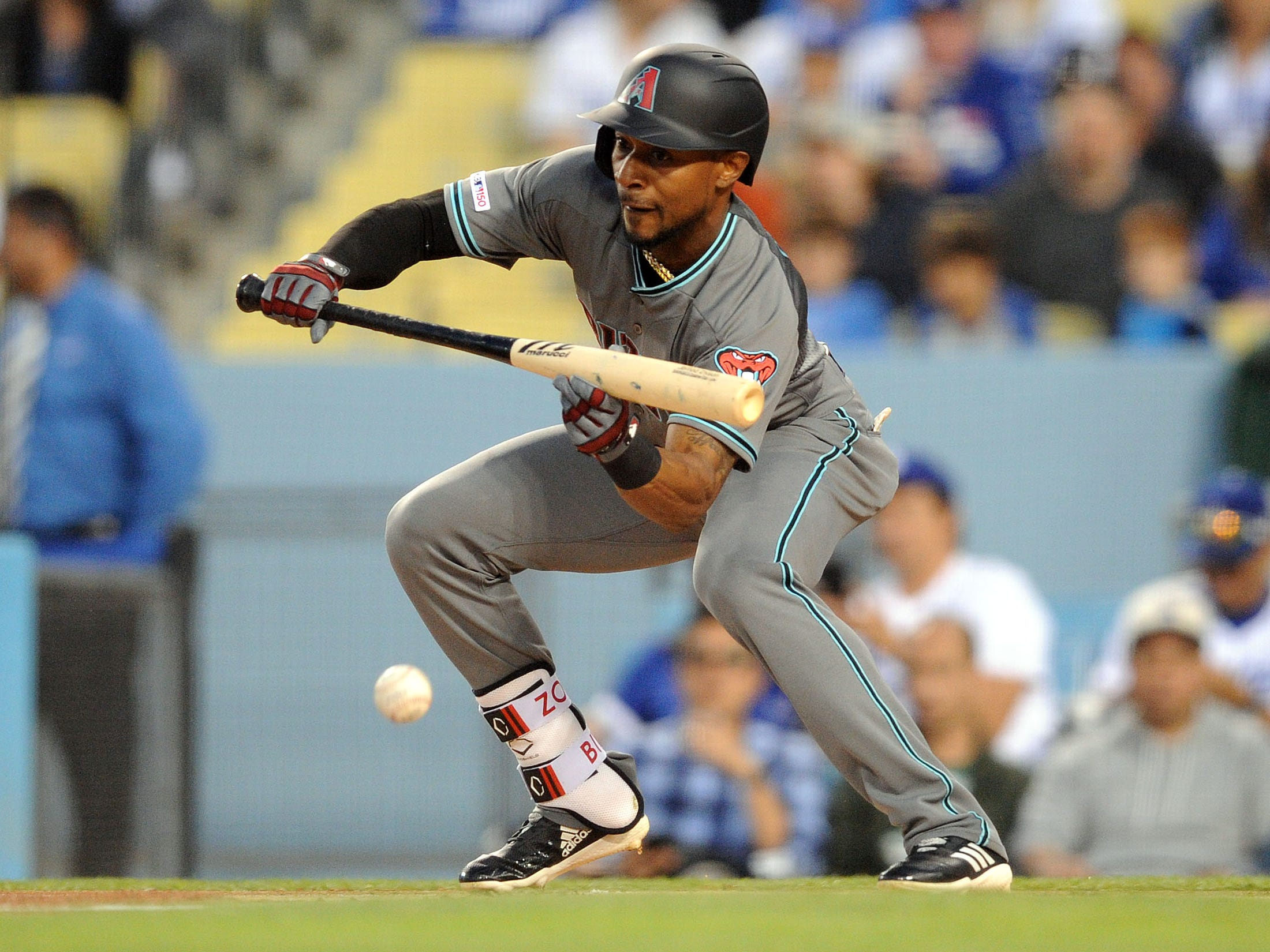 March 29, 2019; Los Angeles, CA, USA; Arizona Diamondbacks center fielder Jarrod Dyson (1) reaches first on a bunt against the Los Angeles Dodgers during the first inning at Dodger Stadium.