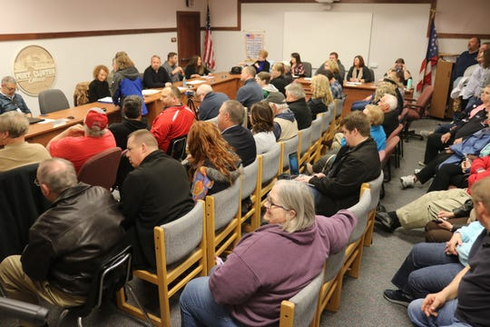 Port Clinton's city council chambers were packed to near standing room only Friday for a special meeting to accept the resignation of former Mayor Hugh Wheeler, who did not attend.
