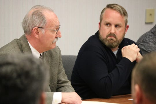 Port Clinton Law Director George Wilber and Councilman Gabe Below discuss the procedure for the selection of a new mayor to finish the remaining term left by Hugh Wheeler, who resigned Thursday, at special meeting of Port Clinton City Council on Friday.