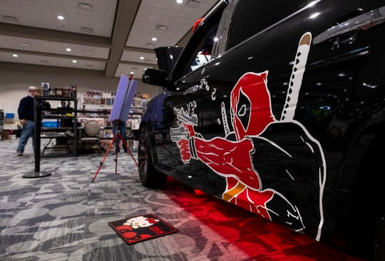 """The Dadpoolmobile--a Ford Flex decorated in Deadpool stickers and other memorabilia--sits on display Saturday, March 30, 2019 during Blue Water International Comic-Con. Before becoming the Dadpoolmobile, the vehicle was decorated and shown as a hearse. """"My wife said no stickers on it,"""" said Trevor Lyn, also known as the Toronto Dadpool, who owns the car. """"That lasted probably about three months."""""""
