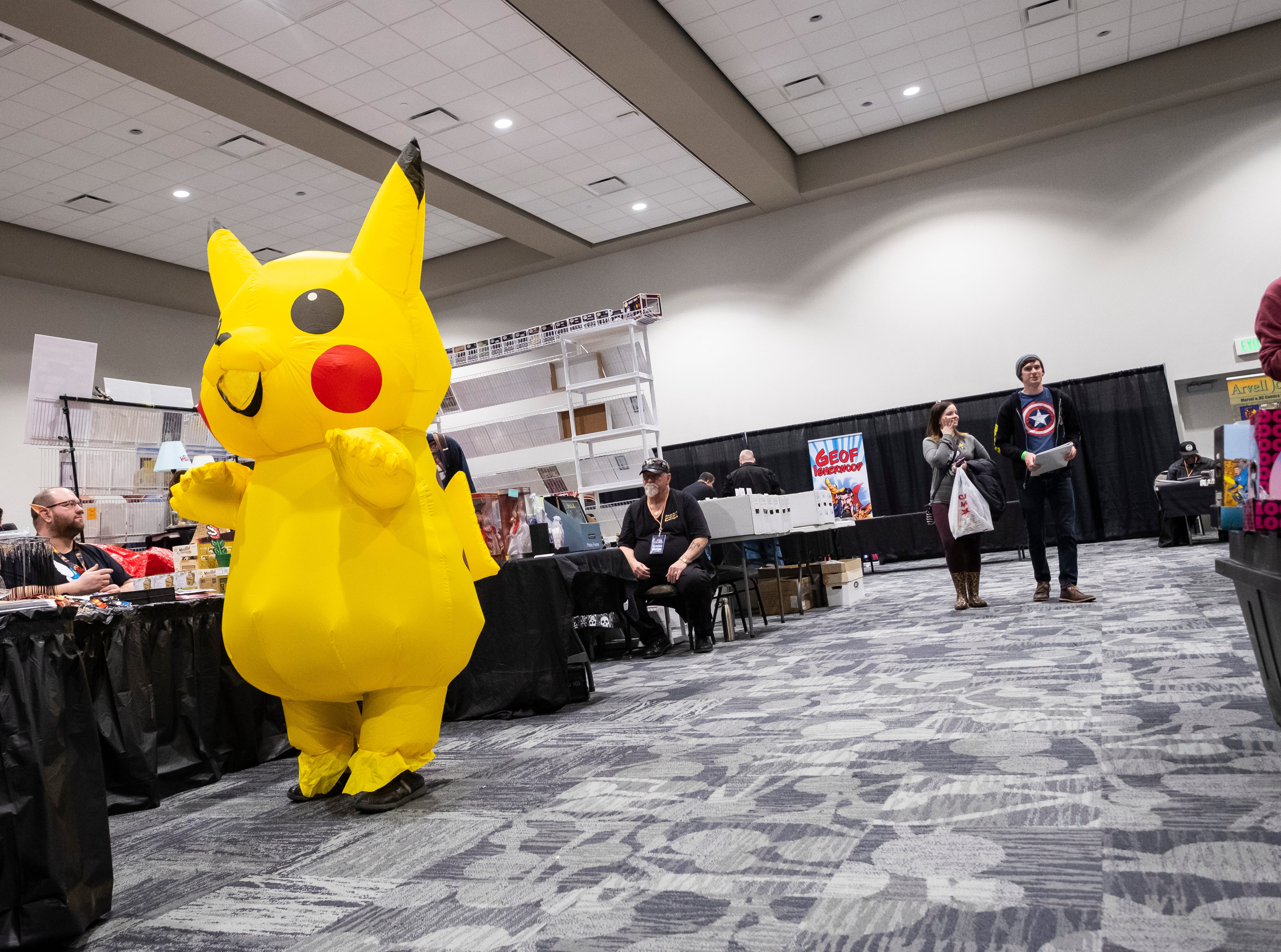 A vendor wearing an inflatable Pikachu costume paces near their booth Saturday, March 30, 2019 during Blue Water International Comic-Con.