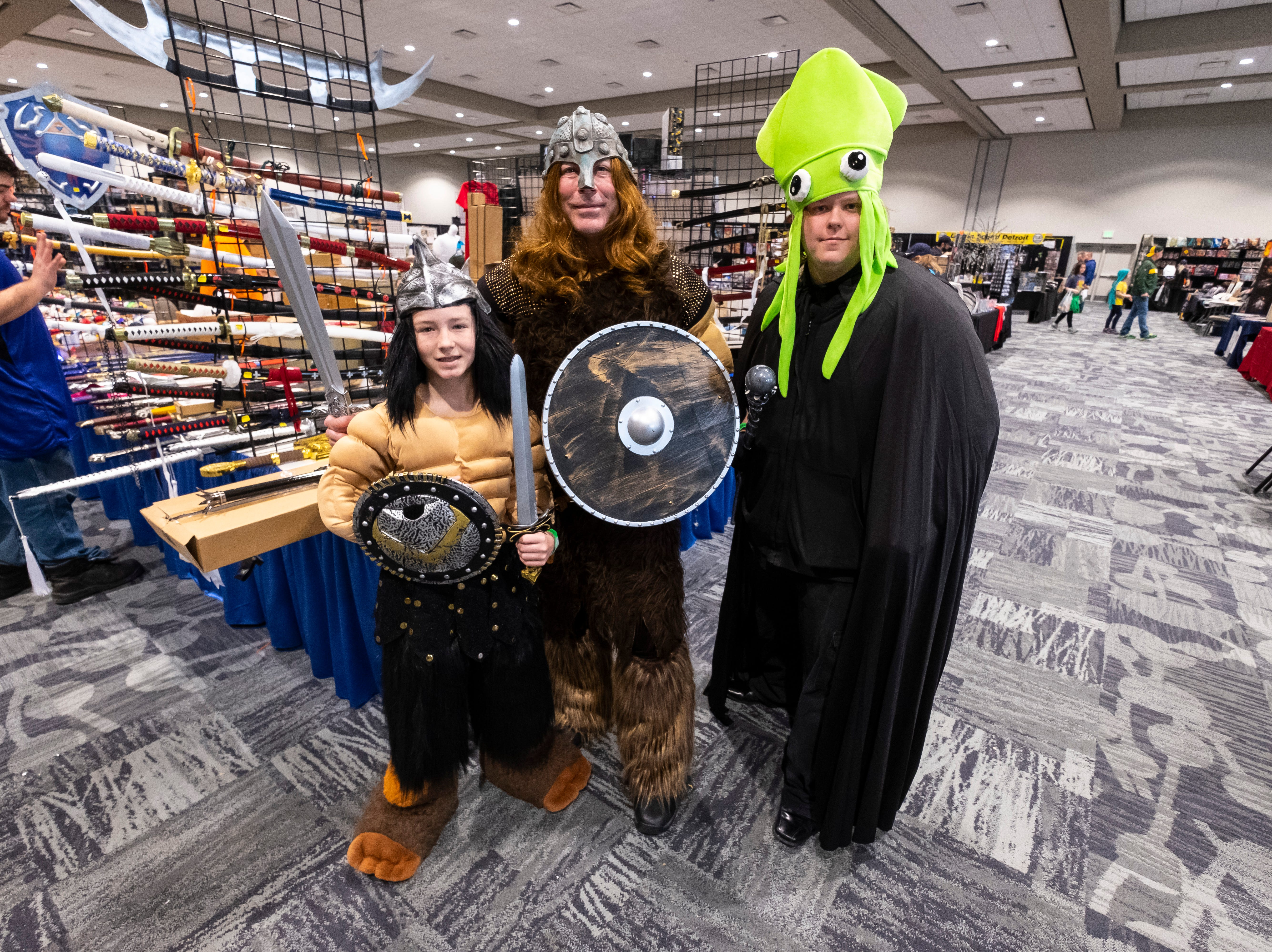 Jeff DeBell, center, of St. Clair, poses in costume with his son Logan, 11, left, and their friend Jared Smith, of Port Huron, Saturday, March 30, 2019 during Blue Water International Comic-Con.