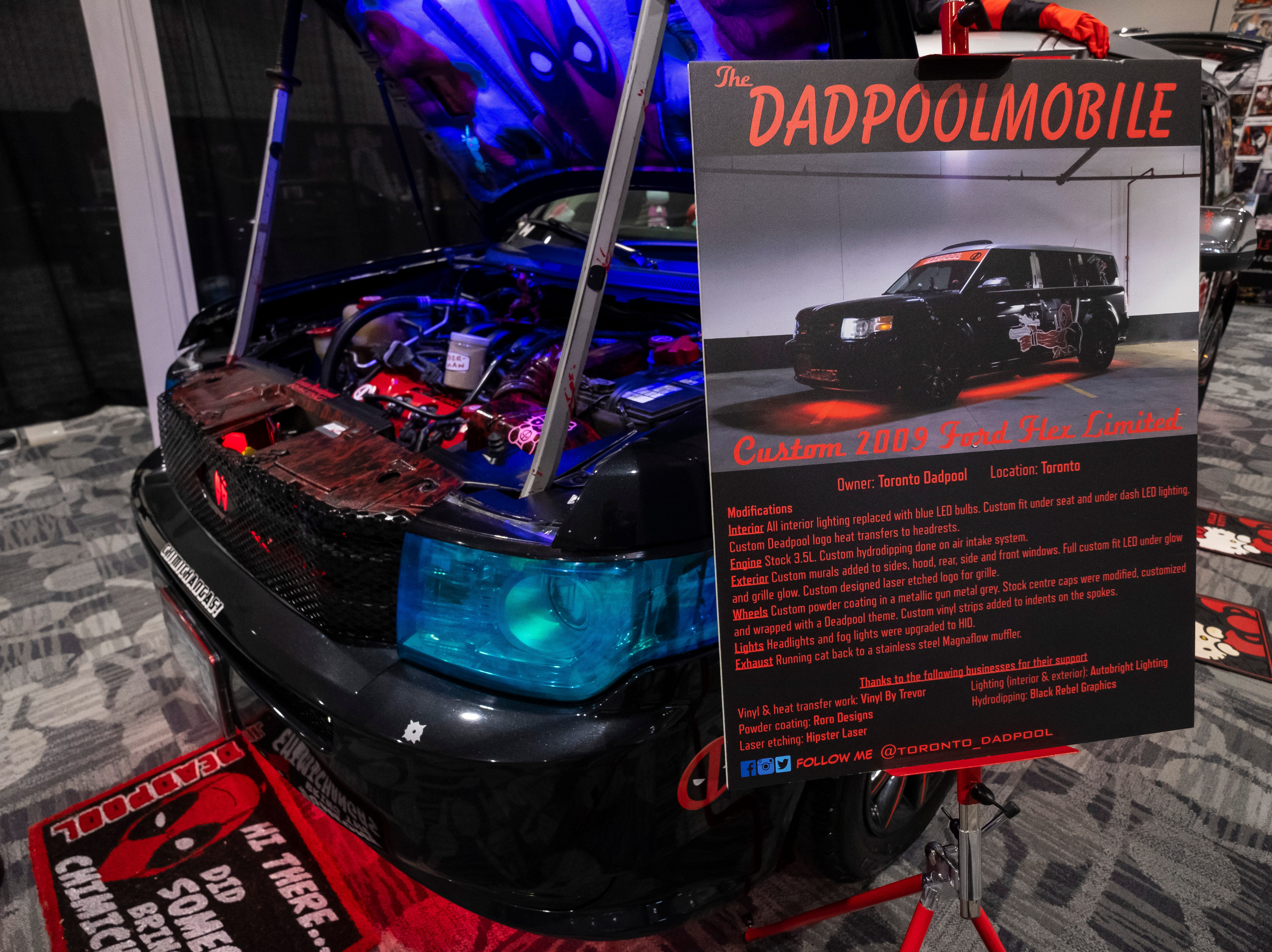 """The Dadpoolmobile--a Ford Flex decorated in Deadpool stickers and other memorabilia--sits on display Saturday, March 30, 2019 during Blue Water International Comic-Con. Before becoming the Dadpoolmobile, the vehicle was decorated and shown as a hearse. """"My wife said no stickers on it,"""" said Trevor Lyn, also known as the Toronto Dadpool. """"That lasted probably about three months."""""""