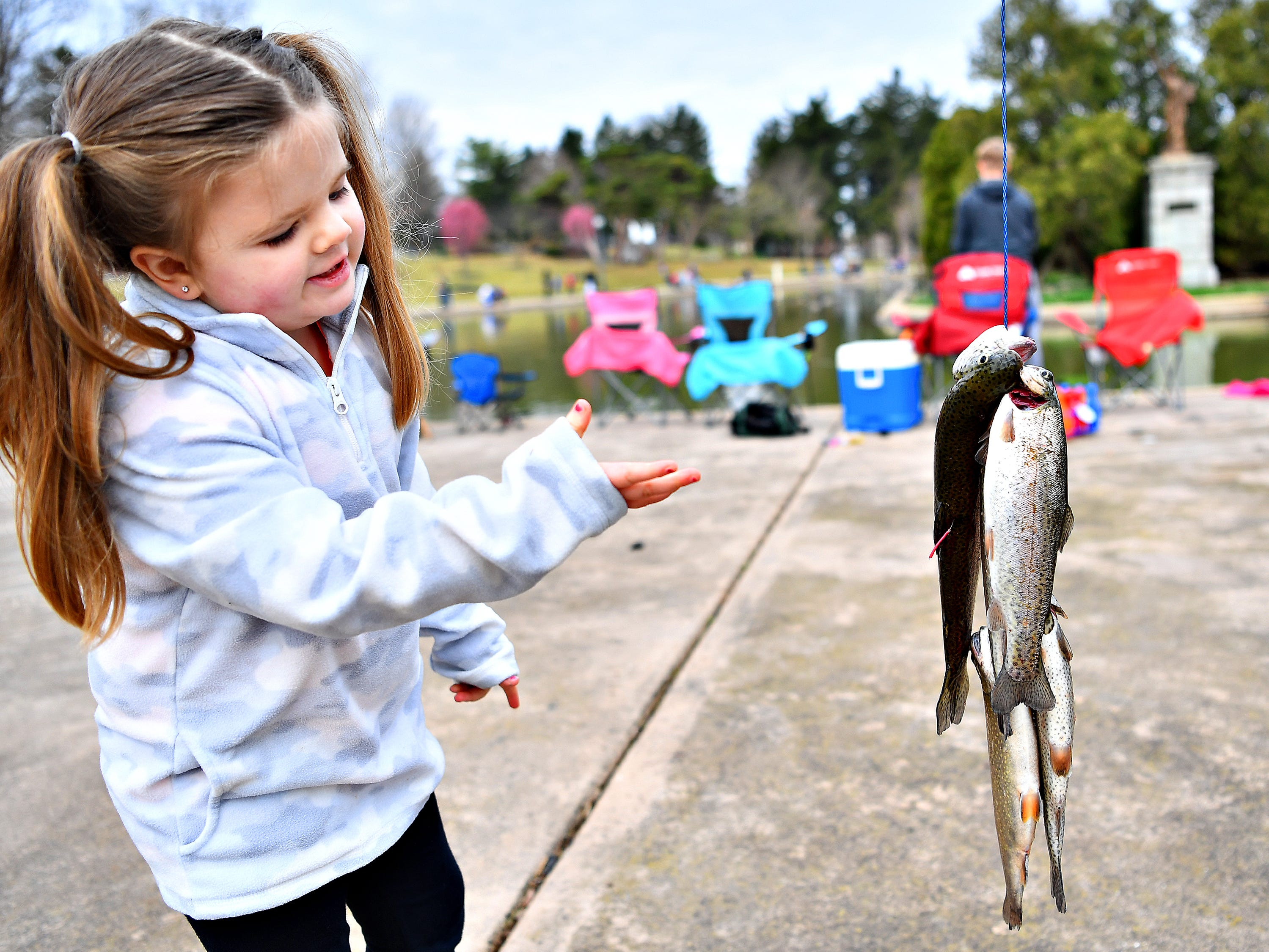 Charley Smith 4, of Spring Garden Township, talks about how some of the fish are tagged during the 21st Annual William Shaffer Trout Fishing Derby at Kiwanis Lake in York City, Saturday, March 30, 2019. Dawn J. Sagert photo