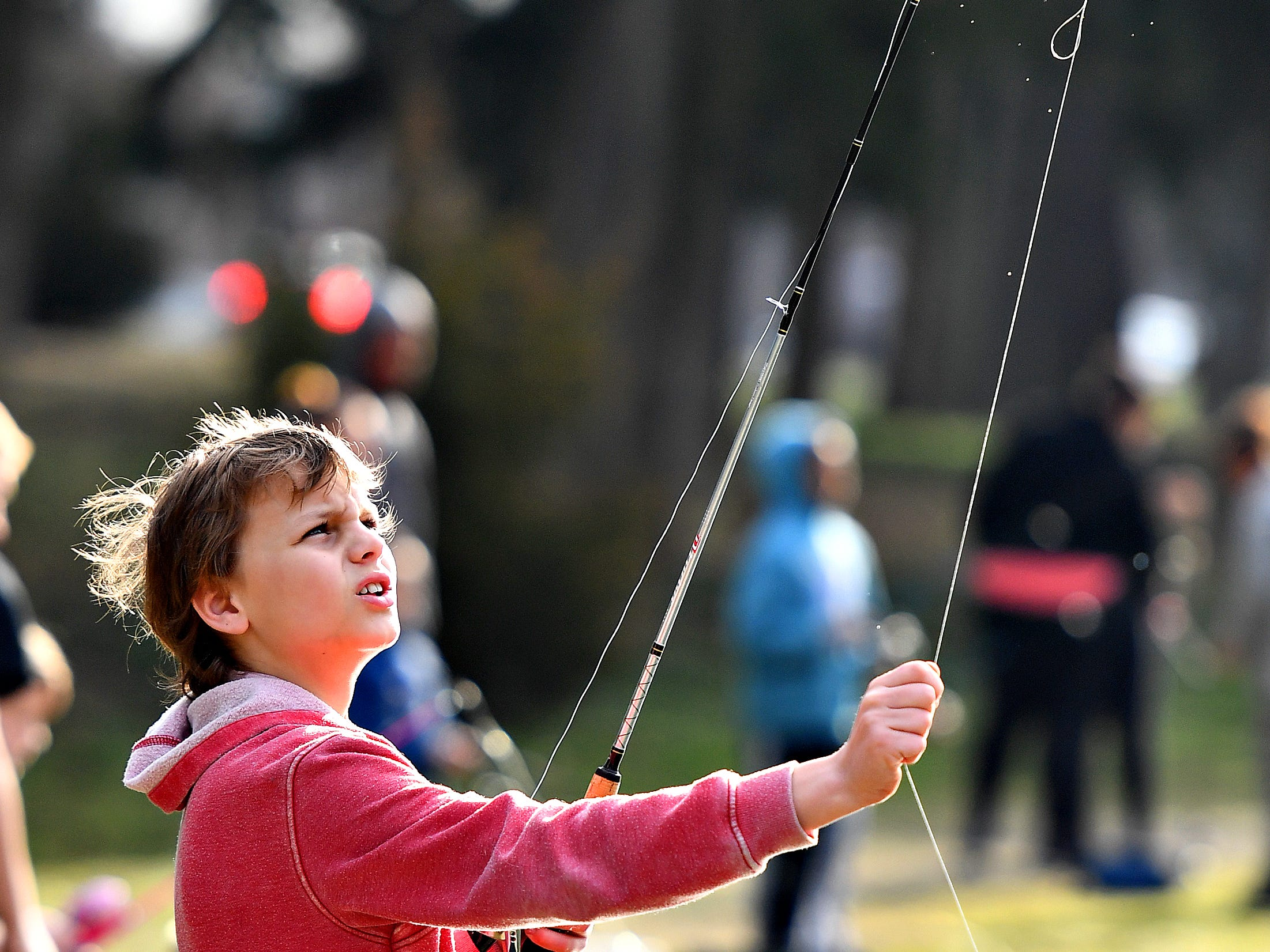 Ian Devos, 10, of Manchester Township, tugs to straighten his fishing line before casting during the 21st Annual William Shaffer Trout Fishing Derby at Kiwanis Lake in York City, Saturday, March 30, 2019. Dawn J. Sagert photo