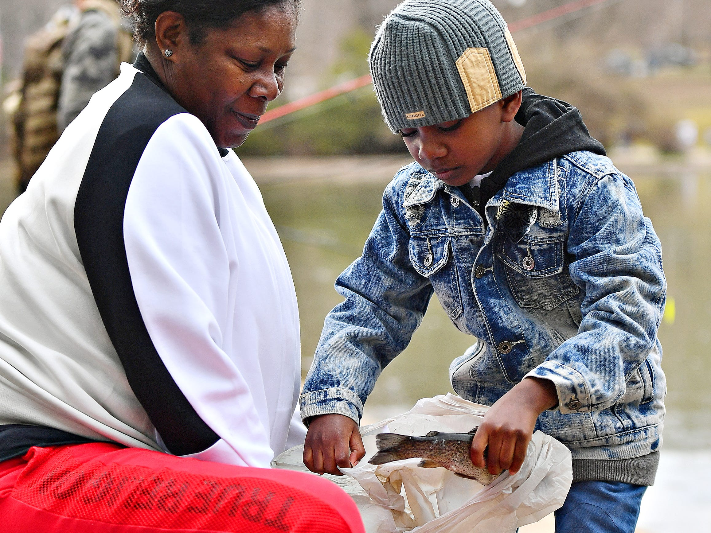 Rosa Duncan, of Mount Wolf, looks on as her grandson Ramel Duncan, 6, of Red Lion, shows the fish that he caught during the 21st Annual William Shaffer Trout Fishing Derby at Kiwanis Lake in York City, Saturday, March 30, 2019. Dawn J. Sagert photo