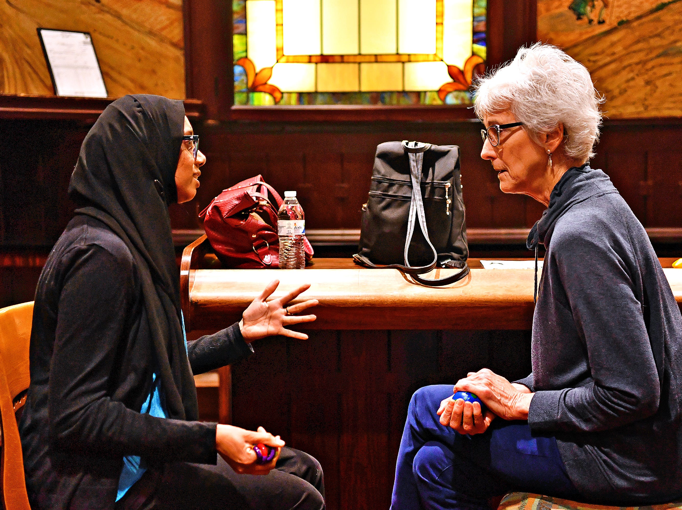 """Rabyia Ahmed, of Springettsbury Township, whose book title is, """"Muslim Woman,"""" talks with Sherry Lookofsky, of Manchester Township, as """"readers"""" interact with a library collection of human """"books"""" during the third Human Library: York event at York College Center for Community Engagement in York City, Saturday, March 30, 2019. Dawn J. Sagert photo"""