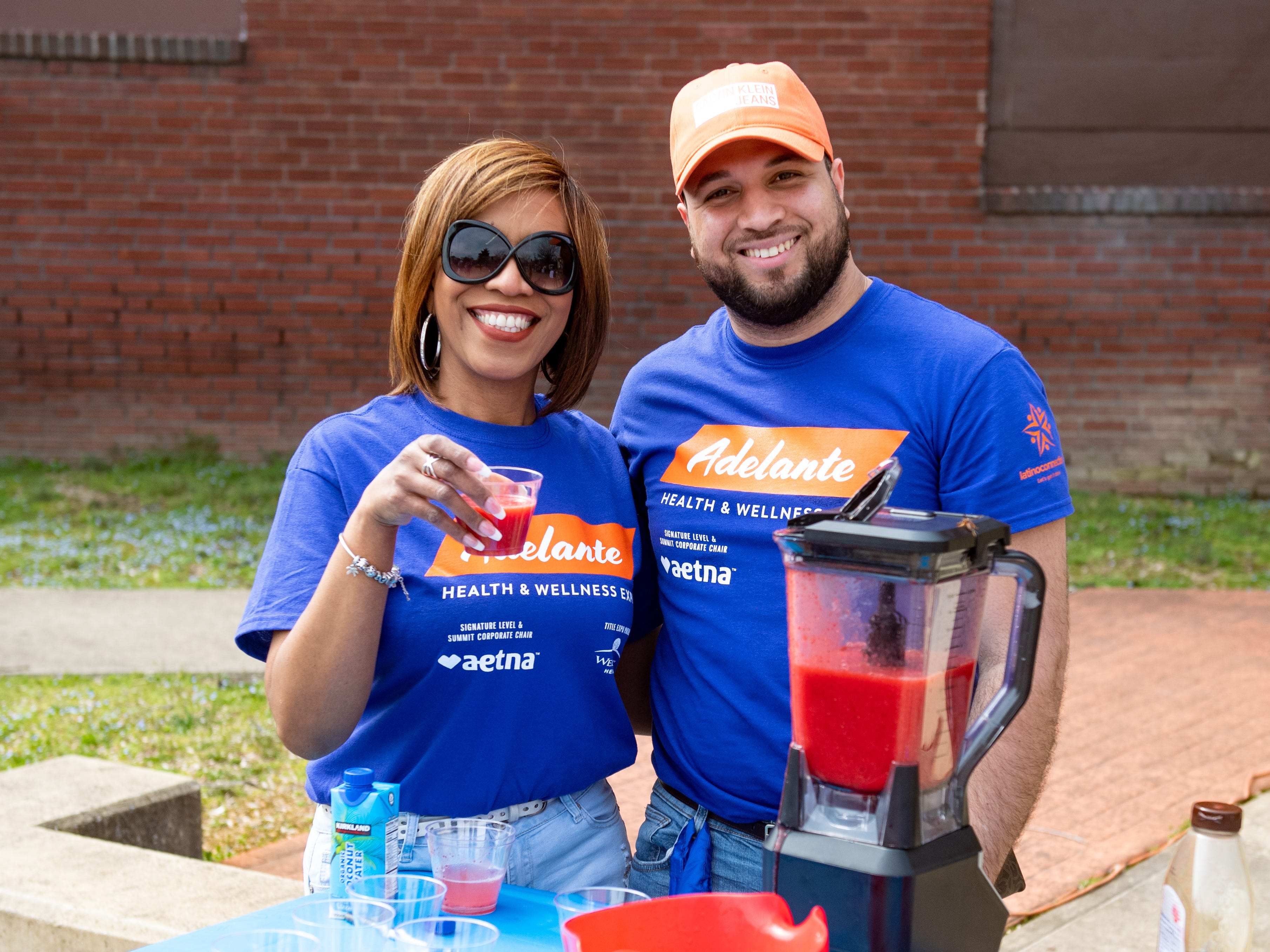 Leslie Ruiz and Pedro Fernandez make and serve smoothies to thirsty festival-goers during the Adelante Festival at Renaissance Park, March 30, 2019.