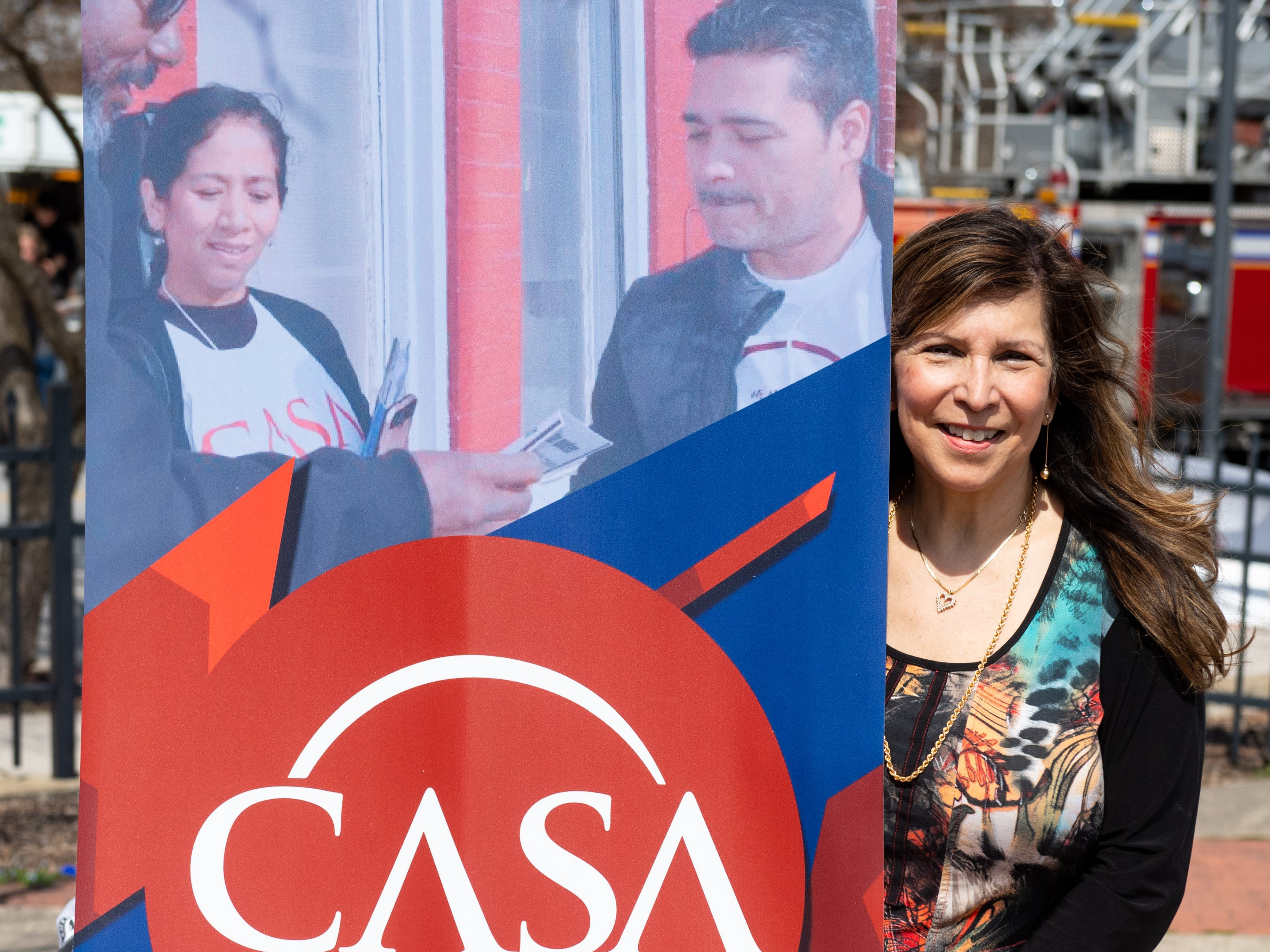 Delma Rivera poses with the CASA sign during the Adelante Festival at Renaissance Park, March 30, 2019.