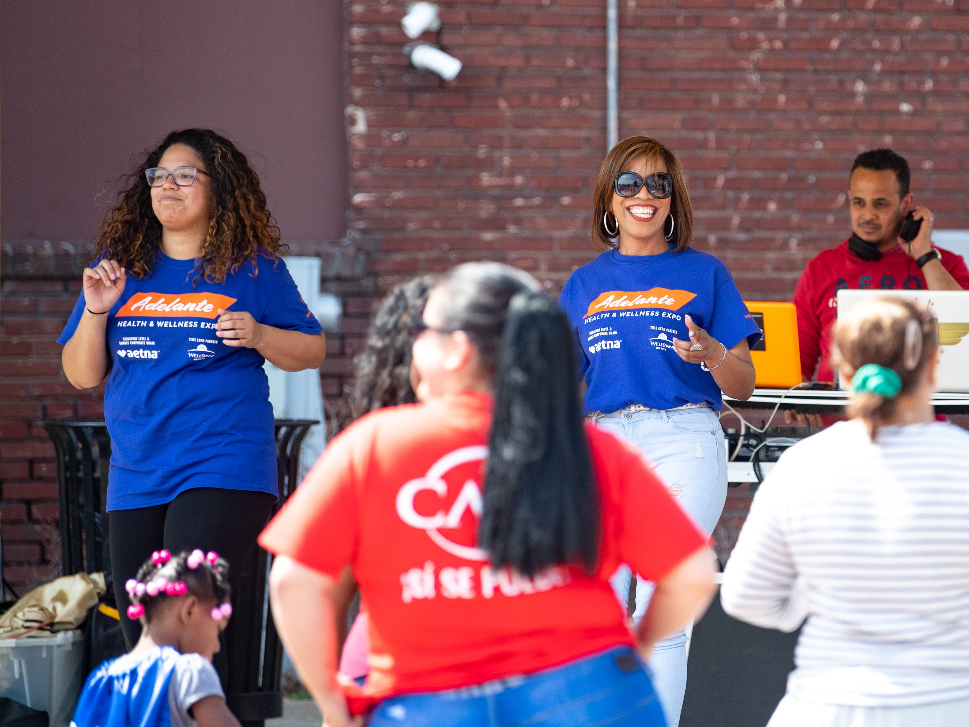 Attendees are taught how to Salsa during the Adelante Festival at Renaissance Park, March 30, 2019.