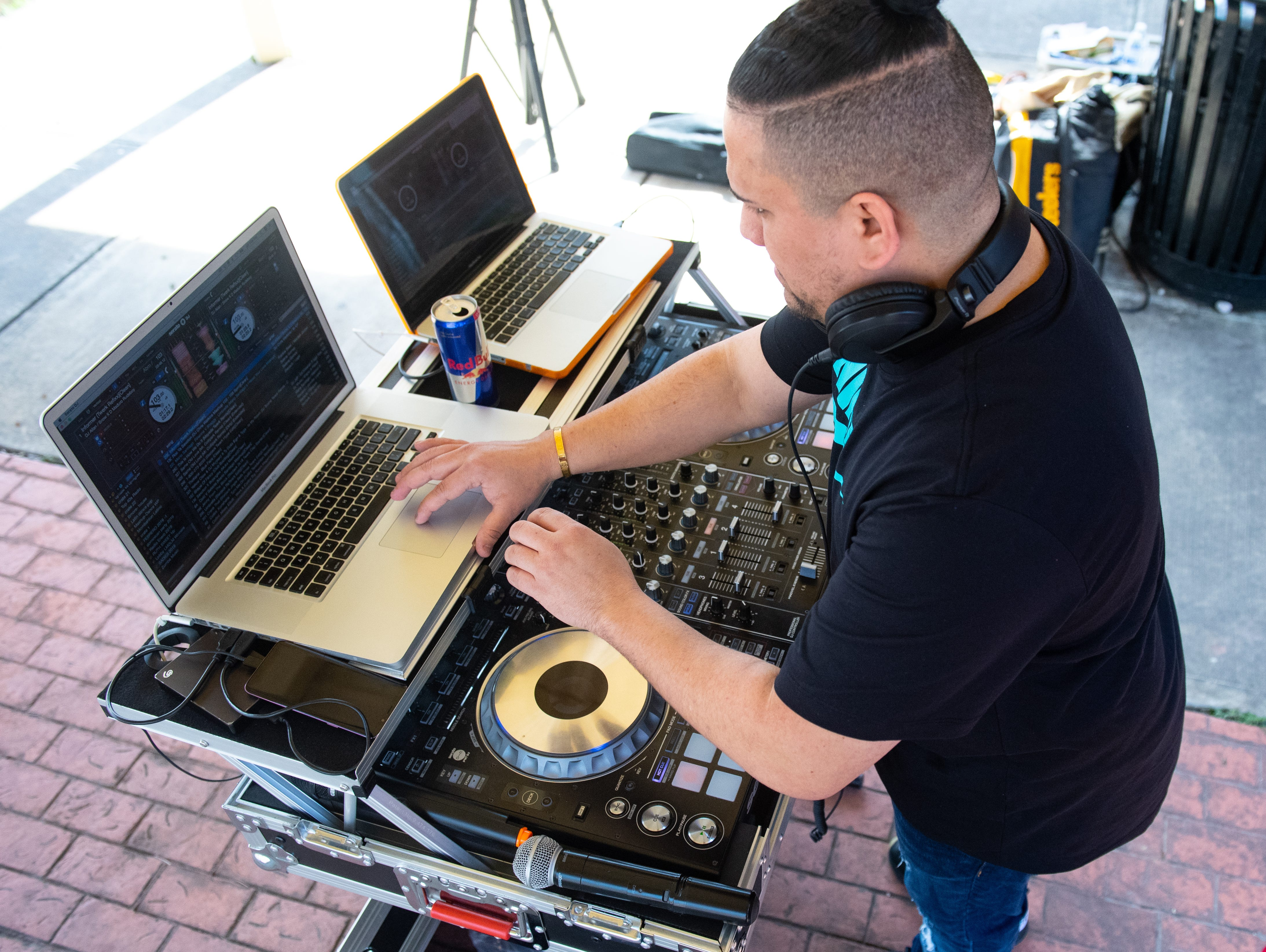 DJ Hery One carefully mixes beats together as festival-goers dance their hearts out during the Adelante Festival at Renaissance Park, March 30, 2019.