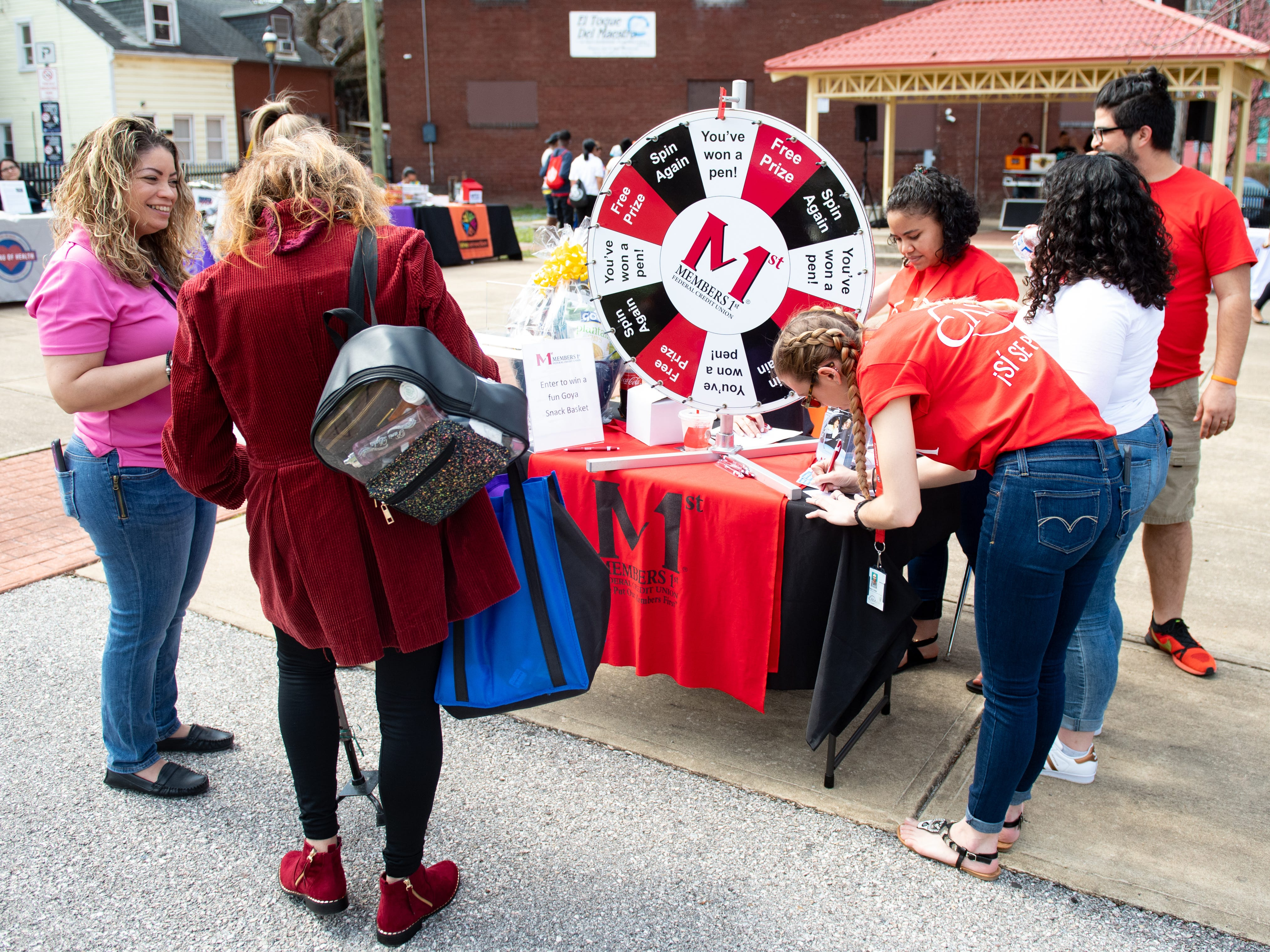 Visitors stop by the many booths at the Adelante Festival to gather health and fitness information, March 30, 2019.