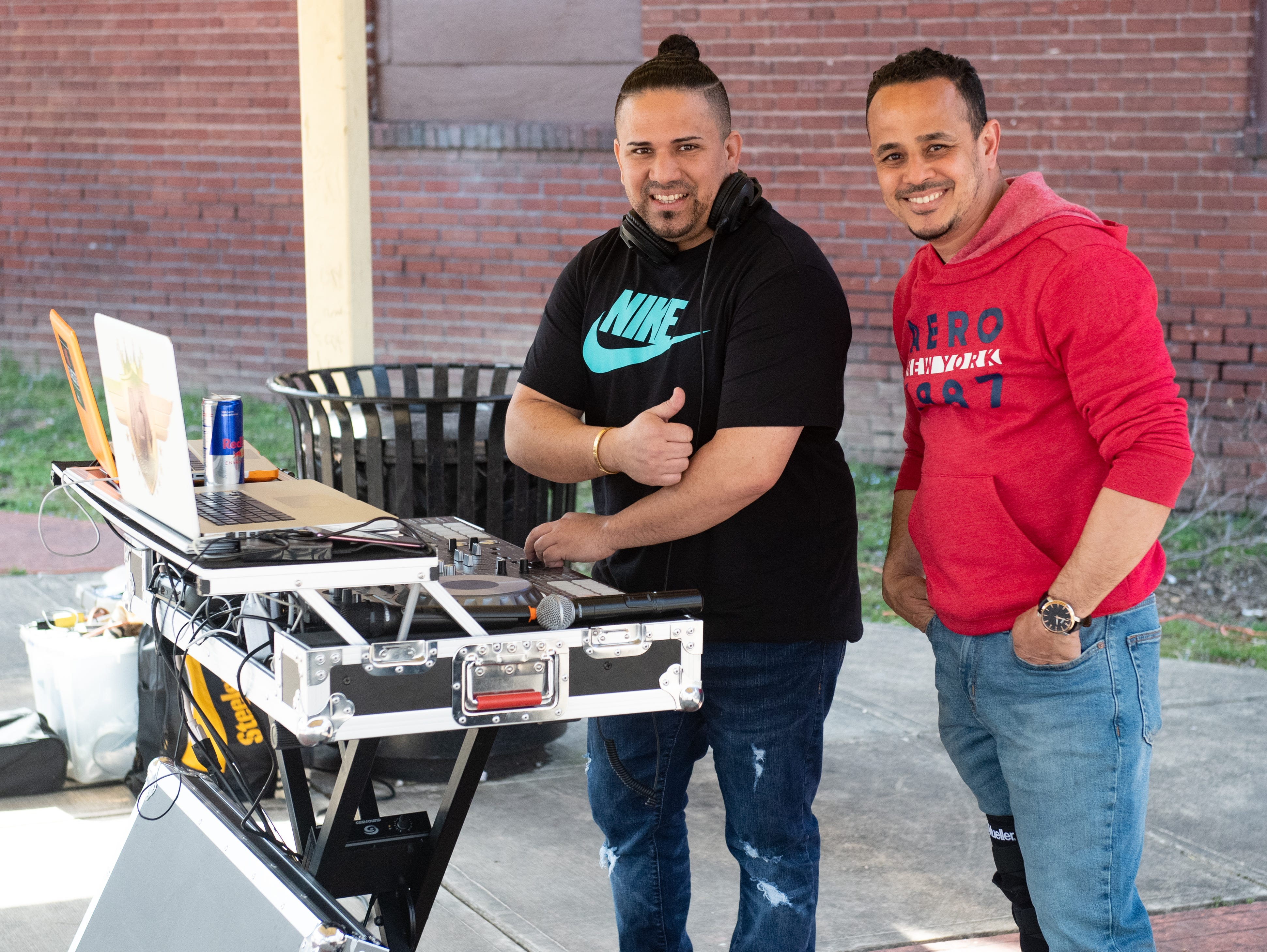 Music is provided by DJ Hery One (left) and DJ Male (right) during the Adelante Festival at Renaissance Park, March 30, 2019.