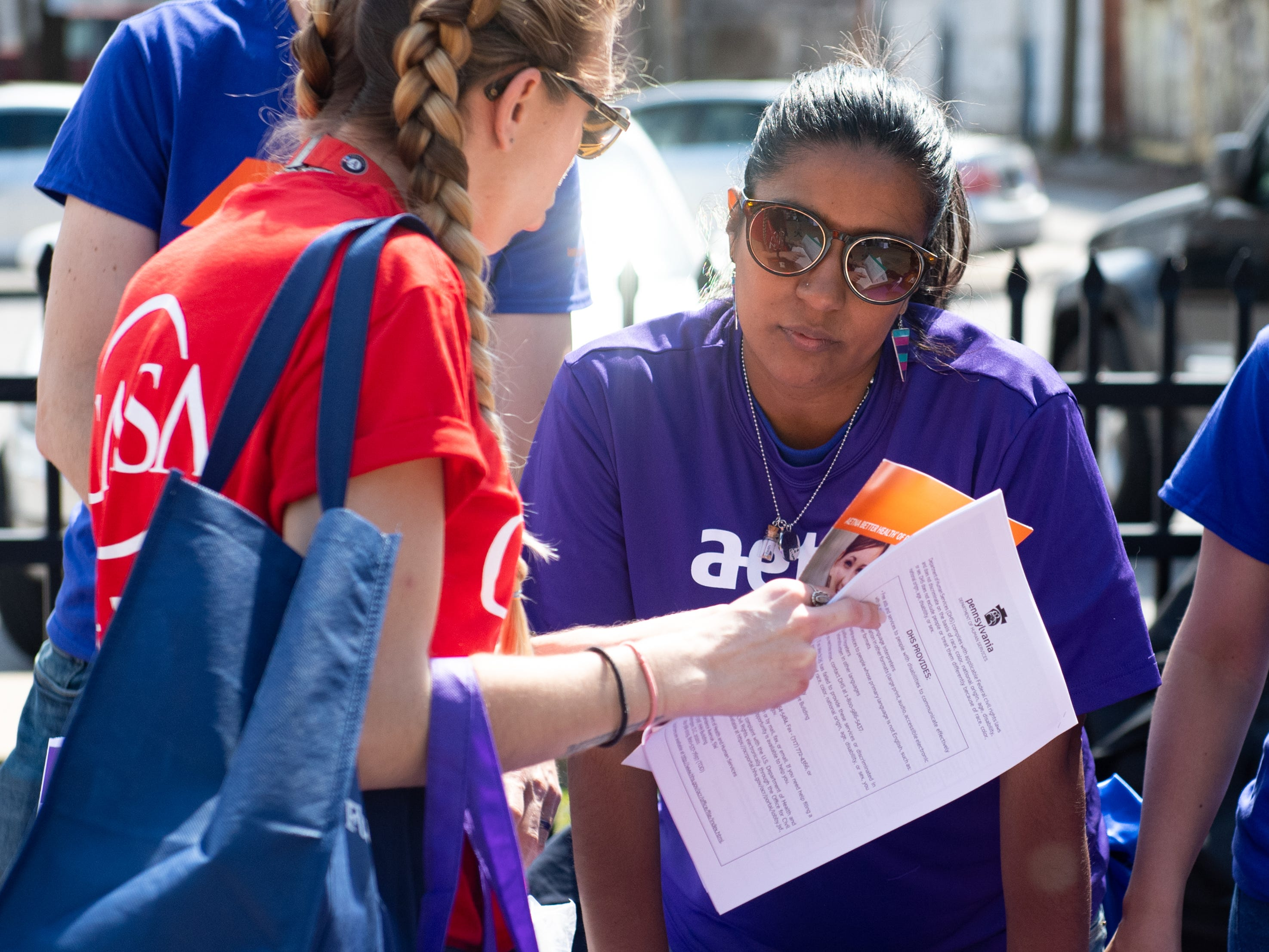 Zuiry Gaytan tells a visitor more about Aetna during the Adelante Festival at Renaissance Park, March 30, 2019.
