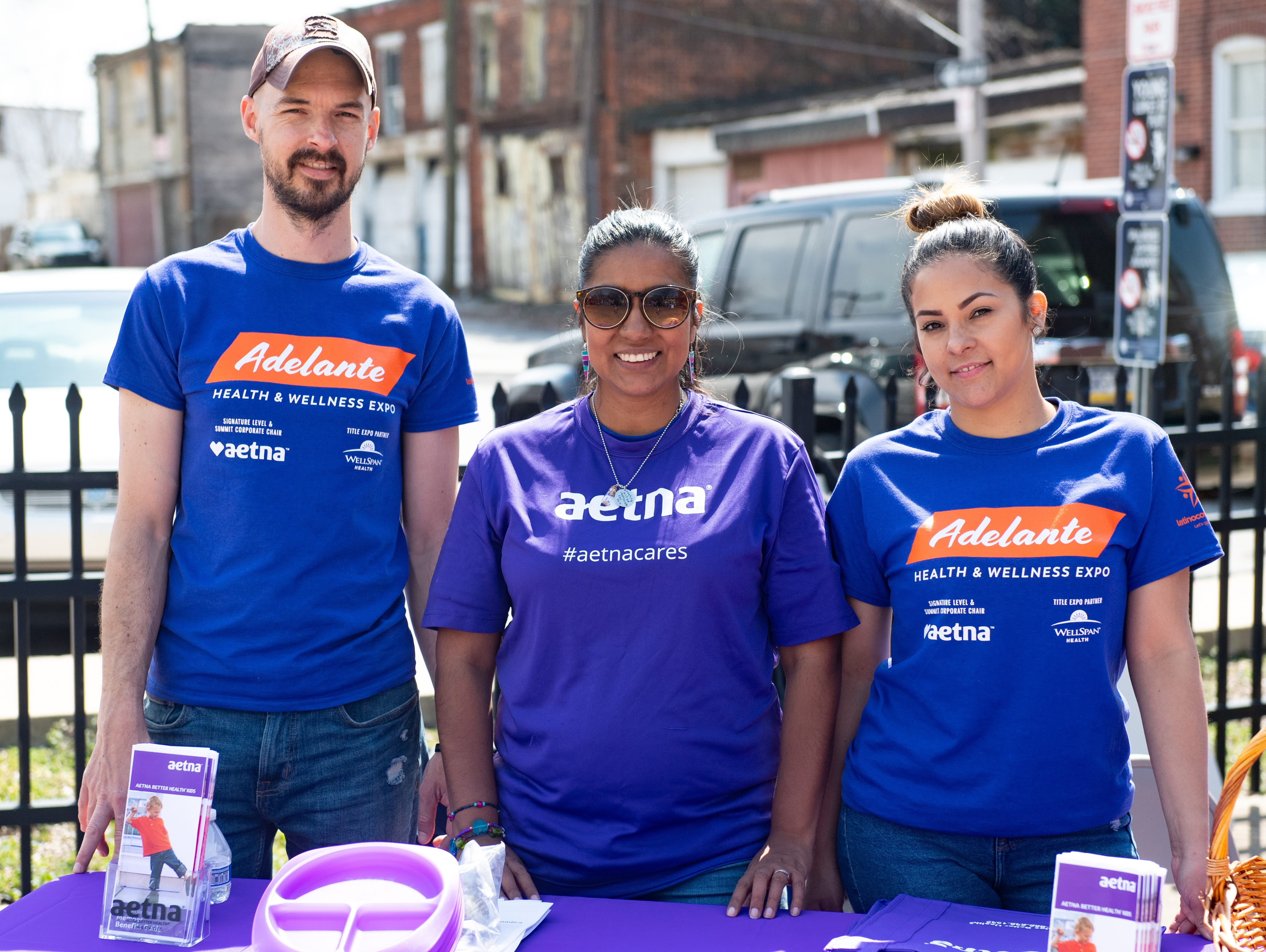 Left to right) Evan Reichley, Zuiry Gaytan and Vedsaida Lorenzo work the Aetna booth during the Adelante Festival at Renaissance Park, March 30, 2019.