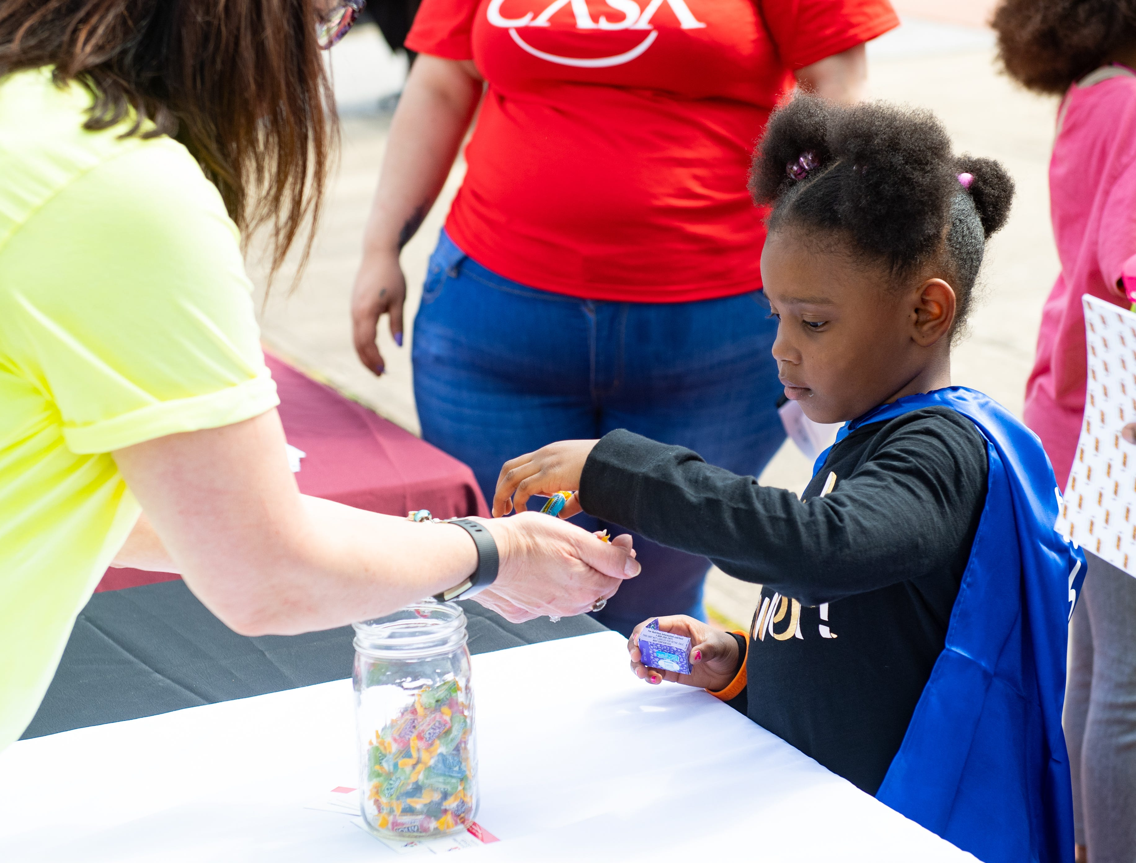 Children are given candy at every booth during the Adelante Festival at Renaissance Park, March 30, 2019.