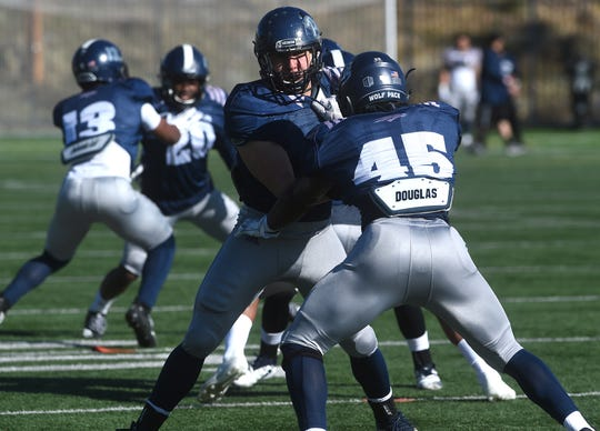 The Nevada football team participates in a spring practice in Reno on March 30.