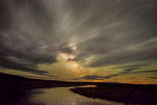 Stars reflect off water flowing to the ephemeral Massacre Lake in the Massacre Rim Wilderness Study Area.