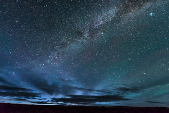Morning light begins to spill across the night sky at 4:17 a.m. on May 2, 2017, in the Massacre Rim Wilderness Study Area in Nevada.