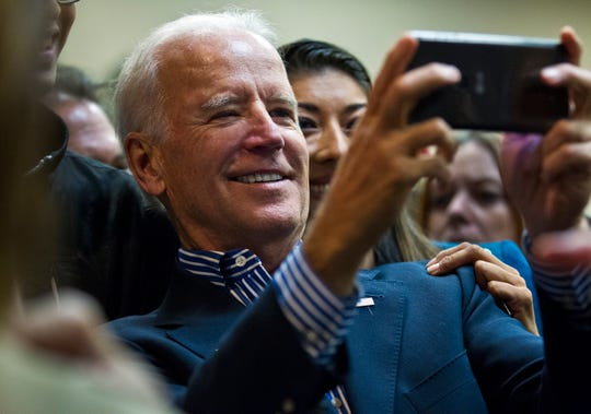 Joe Biden takes a selfie with Lucy Flores during a rally in support of Nevada Democrats at the Plumbers and Pipefitters Joint UA Local 525 in Las Vegas Saturday, Nov. 1, 2014.