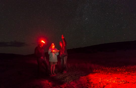 Workers from Friends of Nevada Wilderness survey the night sky from the Massacre Rim Wilderness Study Area on July 14, 2018.