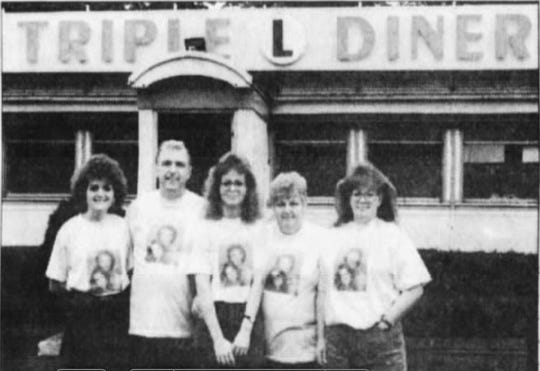 Sept. 24, 1994, from left: Debbie Bowman, James McBride, Linda Stowell, Betty McBride and Sue Cruz stand in front of Triple L Diner, its name for the filming of General Hospital.