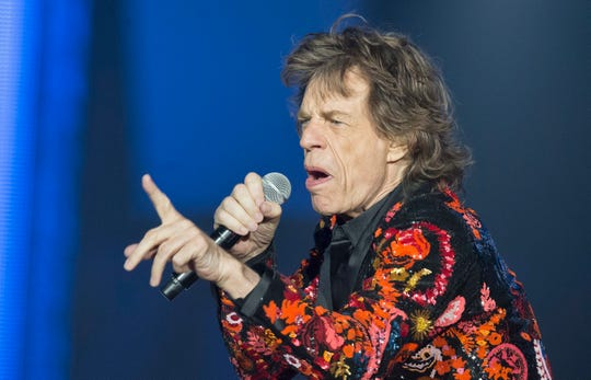 """In this Oct. 22, 2017, file photo, Mick Jagger of the Rolling Stones performs during the concert of their 'No Filter' Europe Tour 2017 at U Arena in Nanterre, outside Paris, France. The Rolling Stones are postponing their latest tour so Jagger can receive medical treatment. The band announced Saturday, March 30, 2019, that Jagger """"has been advised by doctors that he cannot go on tour at this time."""" The band added that Jagger """"is expected to make a complete recovery so that he can get back on stage as soon as possible."""""""