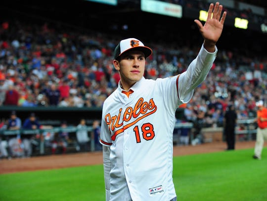 Jun 12, 2018; Baltimore, MD, USA; Baltimore Orioles first round draft pick Grayson Rodriguez (18) waves to the crowd after being introduced during the game against the Boston Red Sox at Oriole Park at Camden Yards. Mandatory Credit: Evan Habeeb-USA TODAY Sports